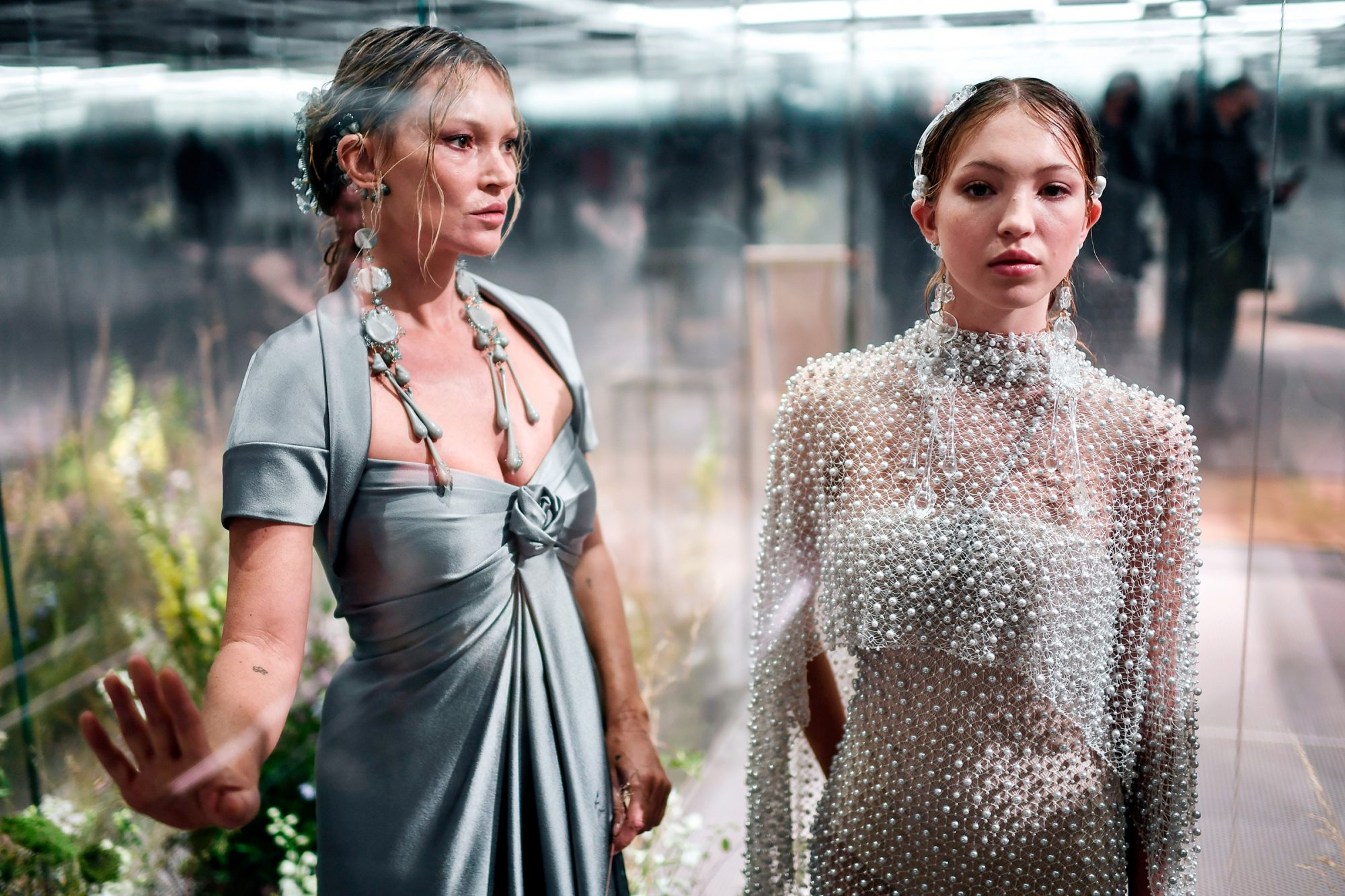 British model Kate Moss (L) and her daughter British model Lila Grace Moss-Hack present creations by British designer Kim Jones for the Fendi's Spring-Summer 2021 collection during the Paris Haute Couture Fashion Week in Paris, on January 27, 2021