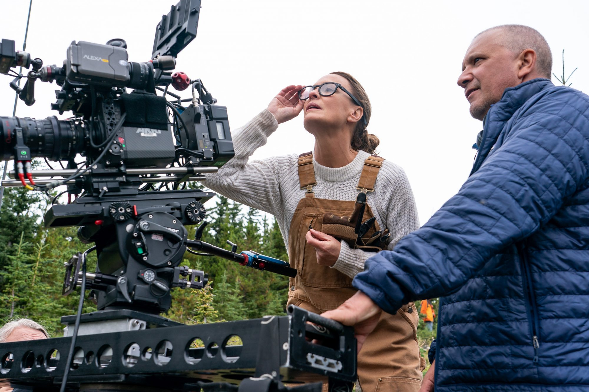 Director / actor Robin Wright (left) and director of photography Bobby Bukowski (right) on the set of LAND, a Focus Features release