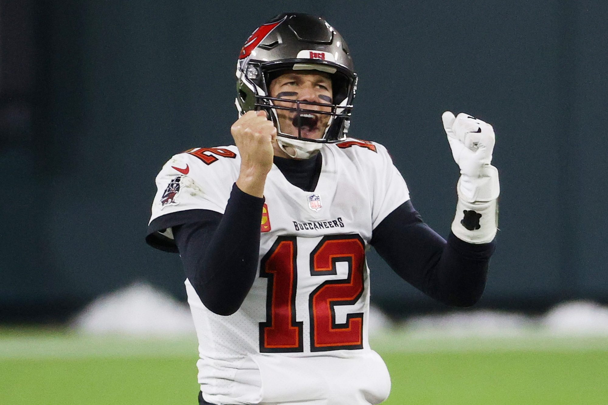 Tom Brady #12 of the Tampa Bay Buccaneers celebrates in the final seconds of their 31 to 26 win over the Green Bay Packers during the NFC Championship game