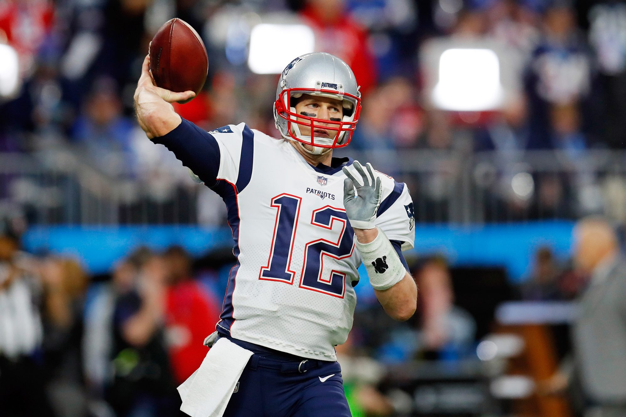 Tom Brady #12 of the New England Patriots warms up prior to Super Bowl LII