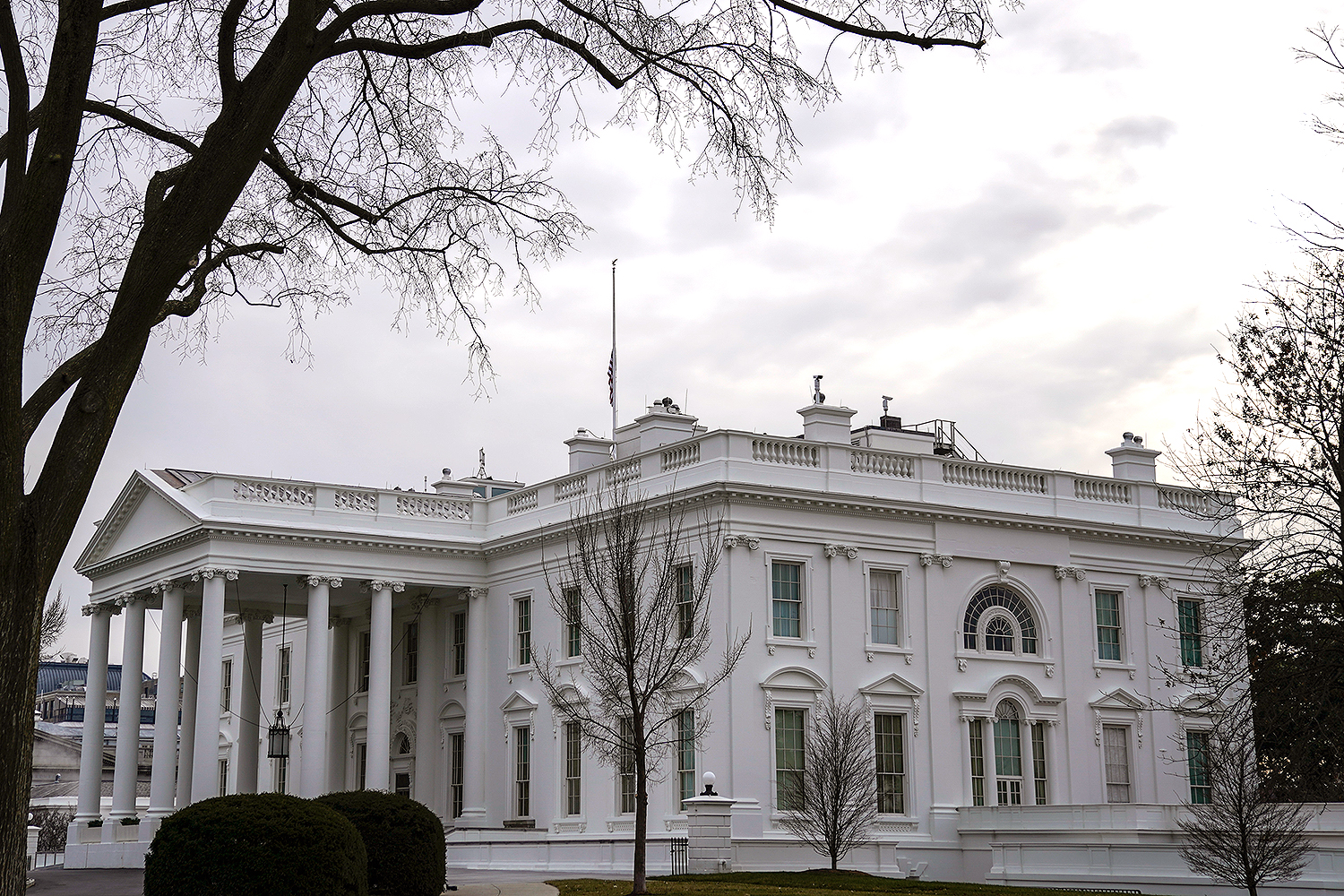 The American flag flies at half staff over the White House