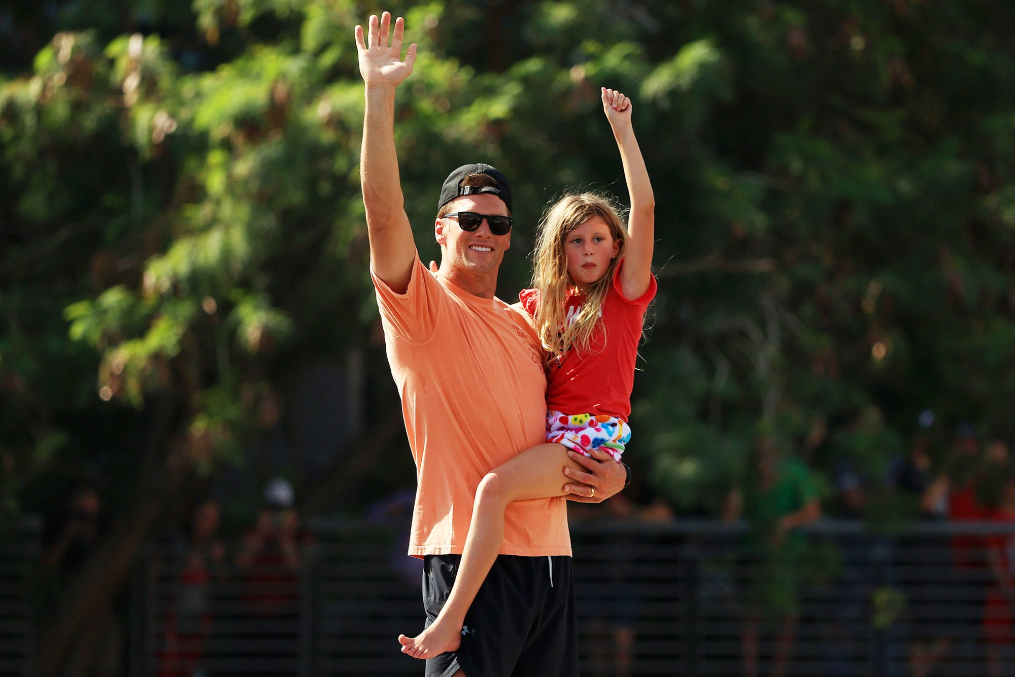 Tom Brady #12 of the Tampa Bay Buccaneers celebrates with his daughter Vivian during the Tampa Bay Buccaneers Super Bowl boat parade on February 10, 2021 after defeating the Kansas City Chiefs 31-9 in Super Bowl LV in Tampa, Florida