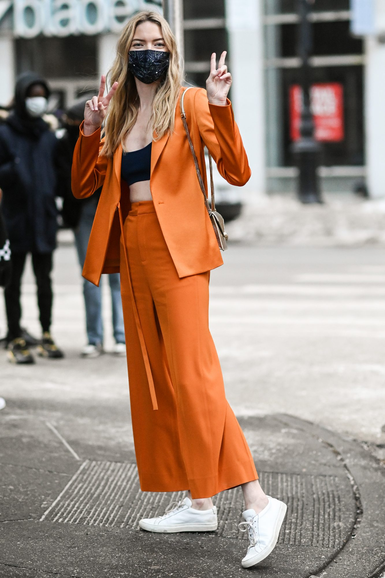 Martha Hunt is seen wearing an orange Jason Wu suit outside the Jason Wu show during New York Fashion Week F/W21 on February 14, 2021 in New York City