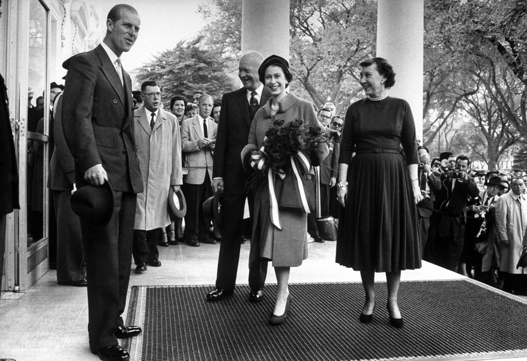 Queen Elizabeth and Prince Philip arriving at the White House and greet President Eisenhower, Washington, District of Columbia, 1957