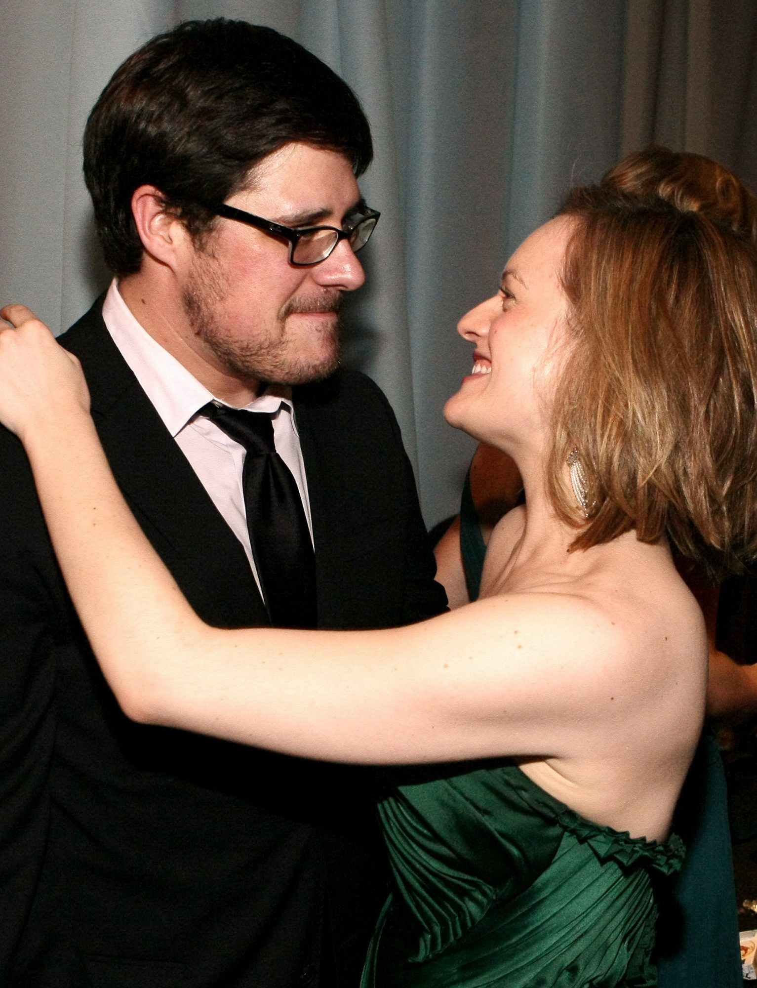 Rich Sommer (L) and Elisabeth Moss attend AMC's 2011 Golden Globe Awards Party held at The Beverly Hilton hotel