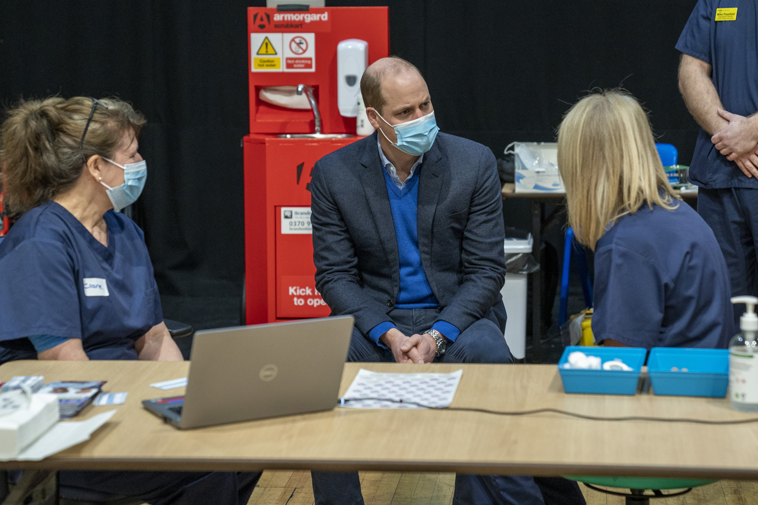 The Duke of Cambridge speaks to a member of the vaccination team during his visit to the King's Lynn Corn Exchange Vaccination Centre