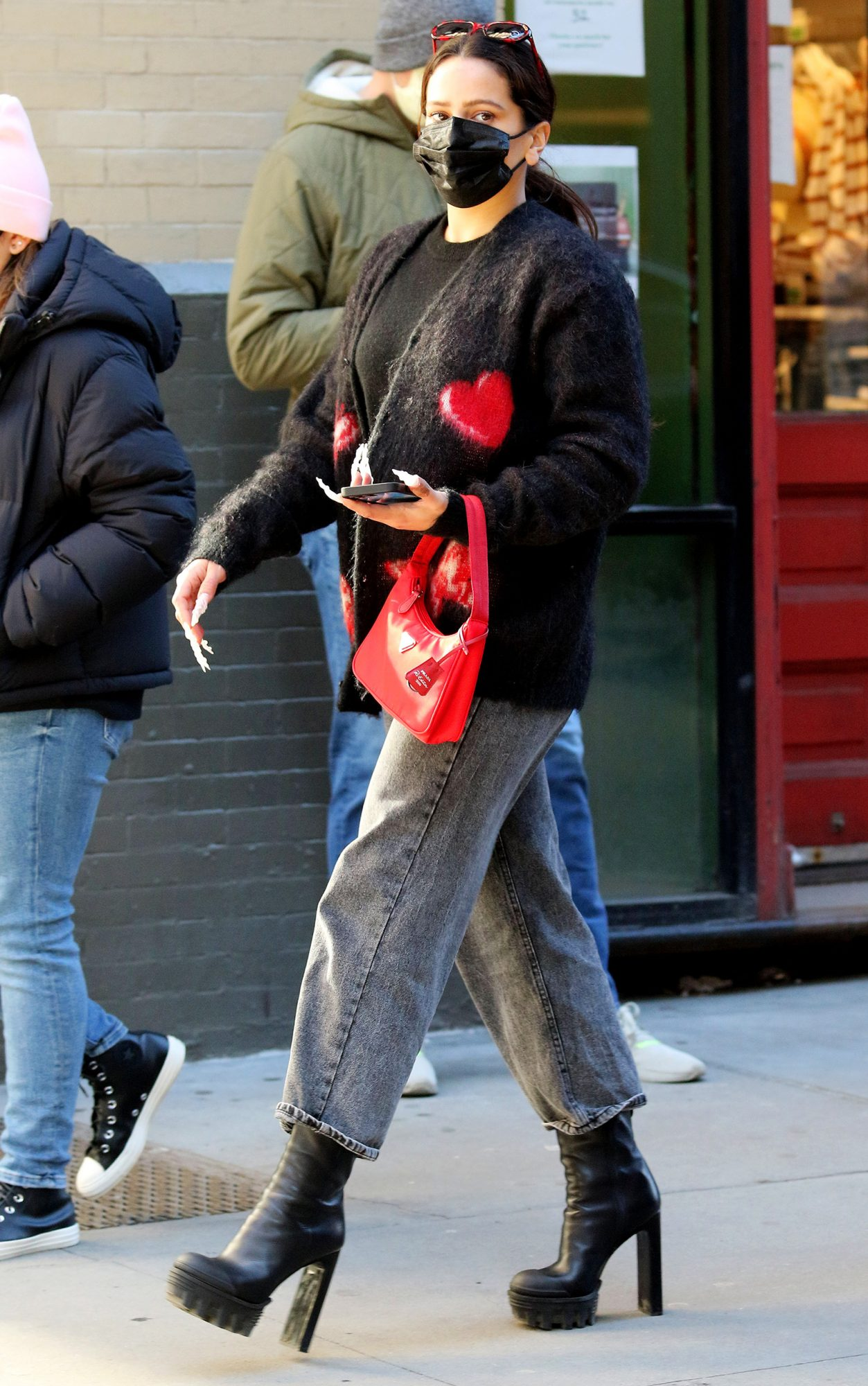 Singer ROSALIA eats pizza while looking stylish with high heel boots and sporting long nails in NYC