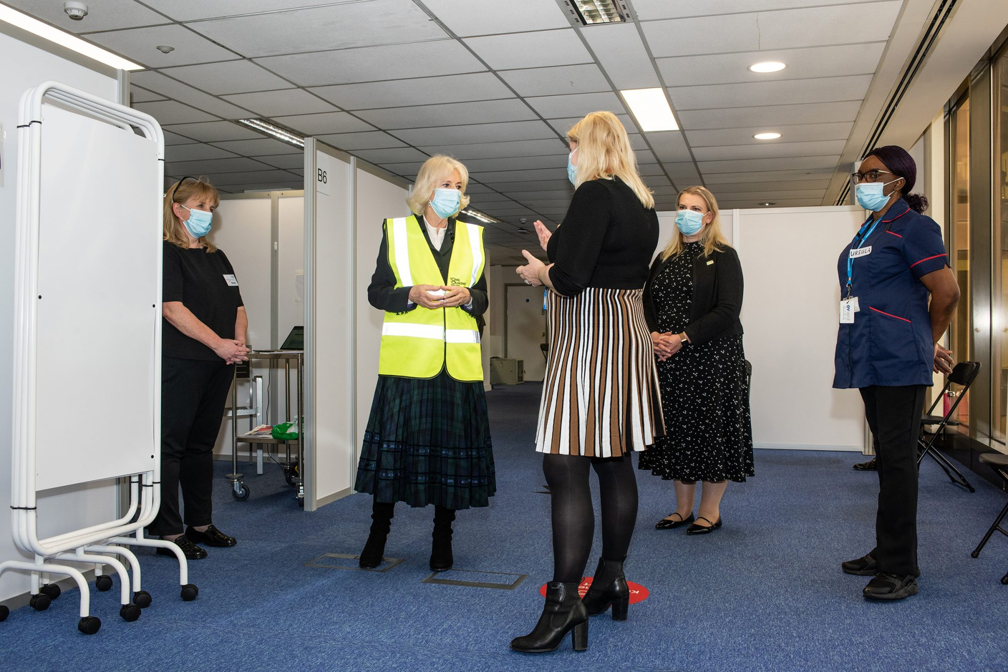 Royal Voluntary Service President, HRH The Duchess of Cornwall, speaks to Chief Nurse of NHS North West London, Pippa Nightingale, while visiting Wembley Park Vaccination Centre to meet NHS Volunteer Responder Stewards.