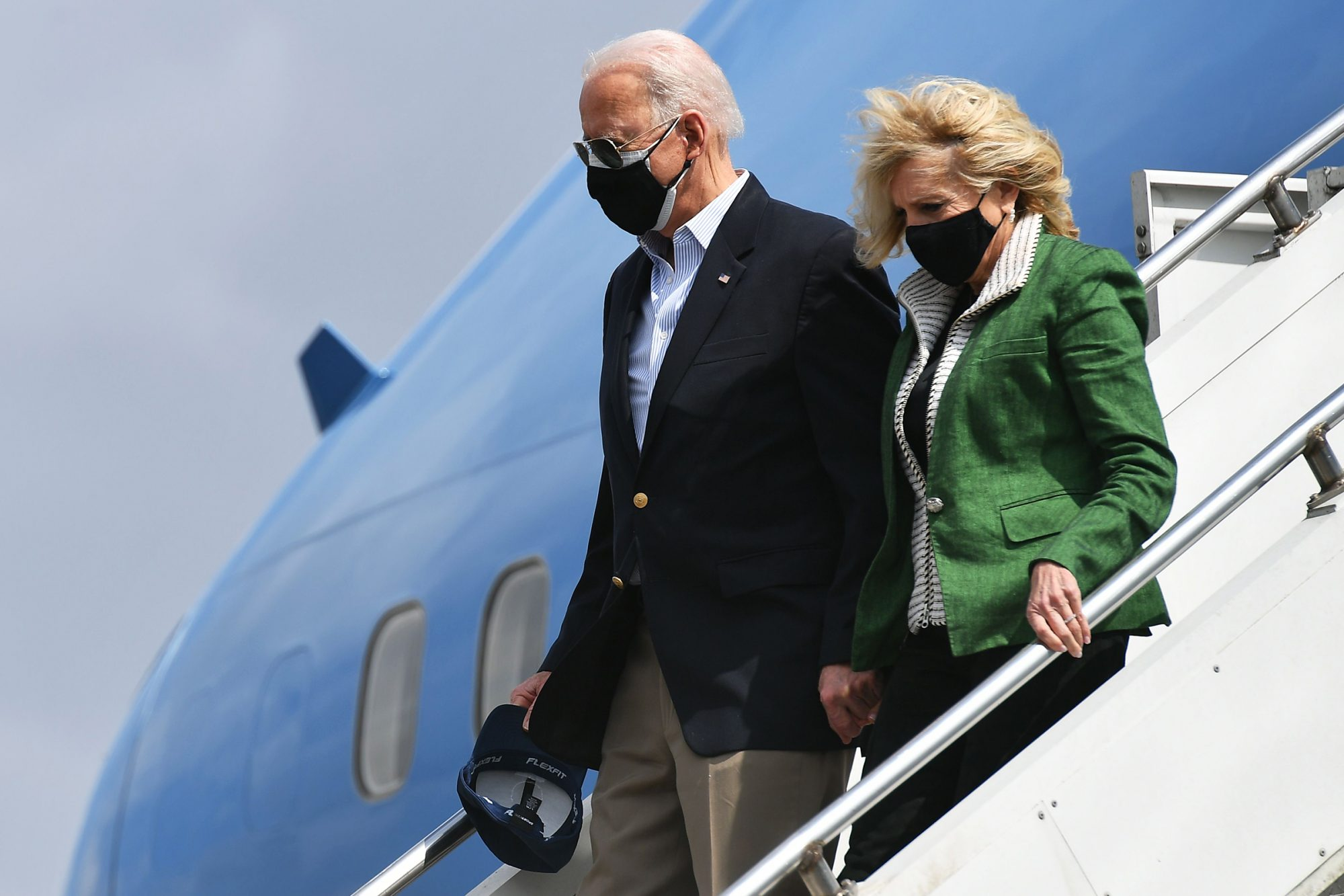 President Joe Biden and First Lady Jill Biden step off Air Force One upon arrival at Ellington Field Joint Reserve Base in Houston, Texas on February 26, 2021