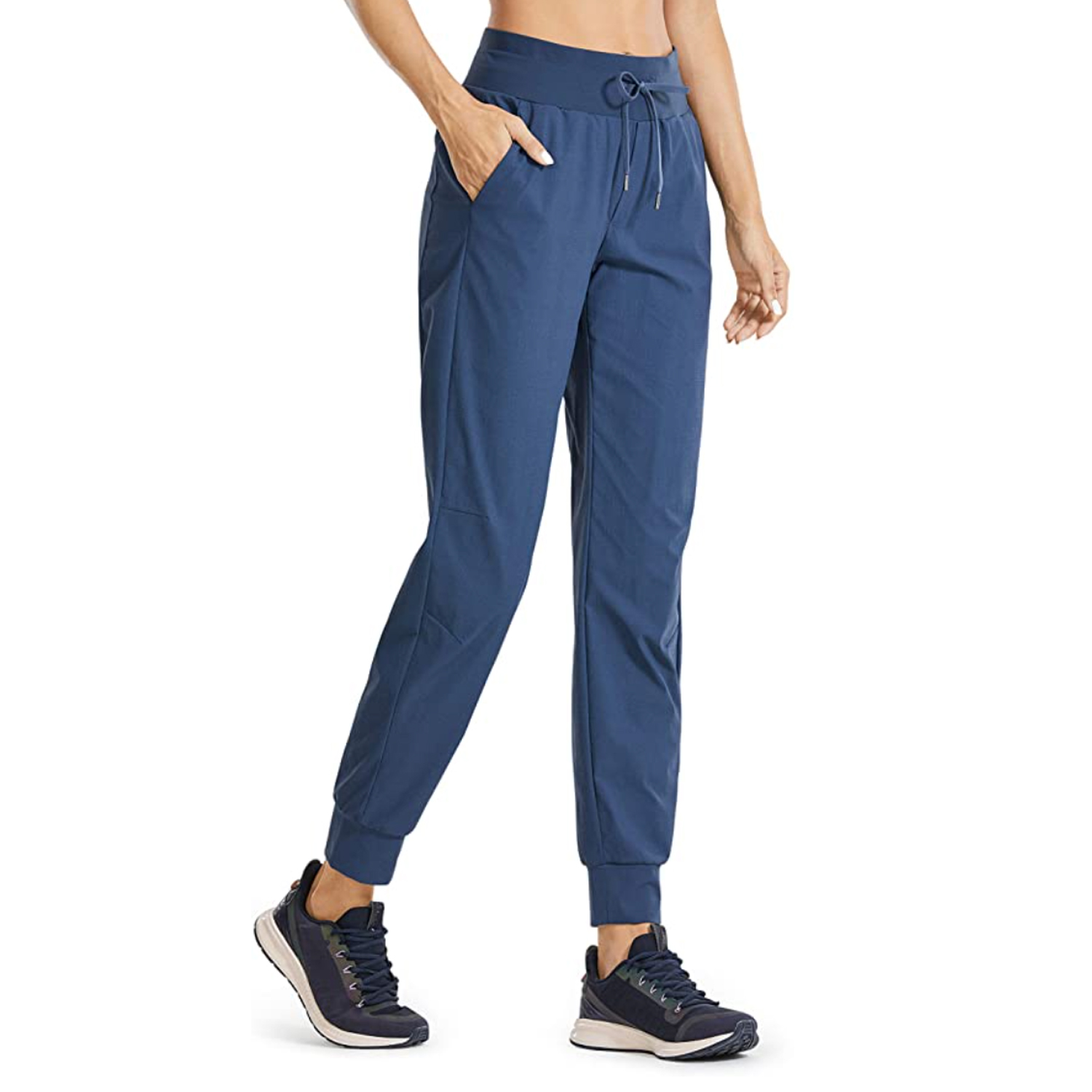 woman wearing navy blue hiking pants and navy tennis shoes