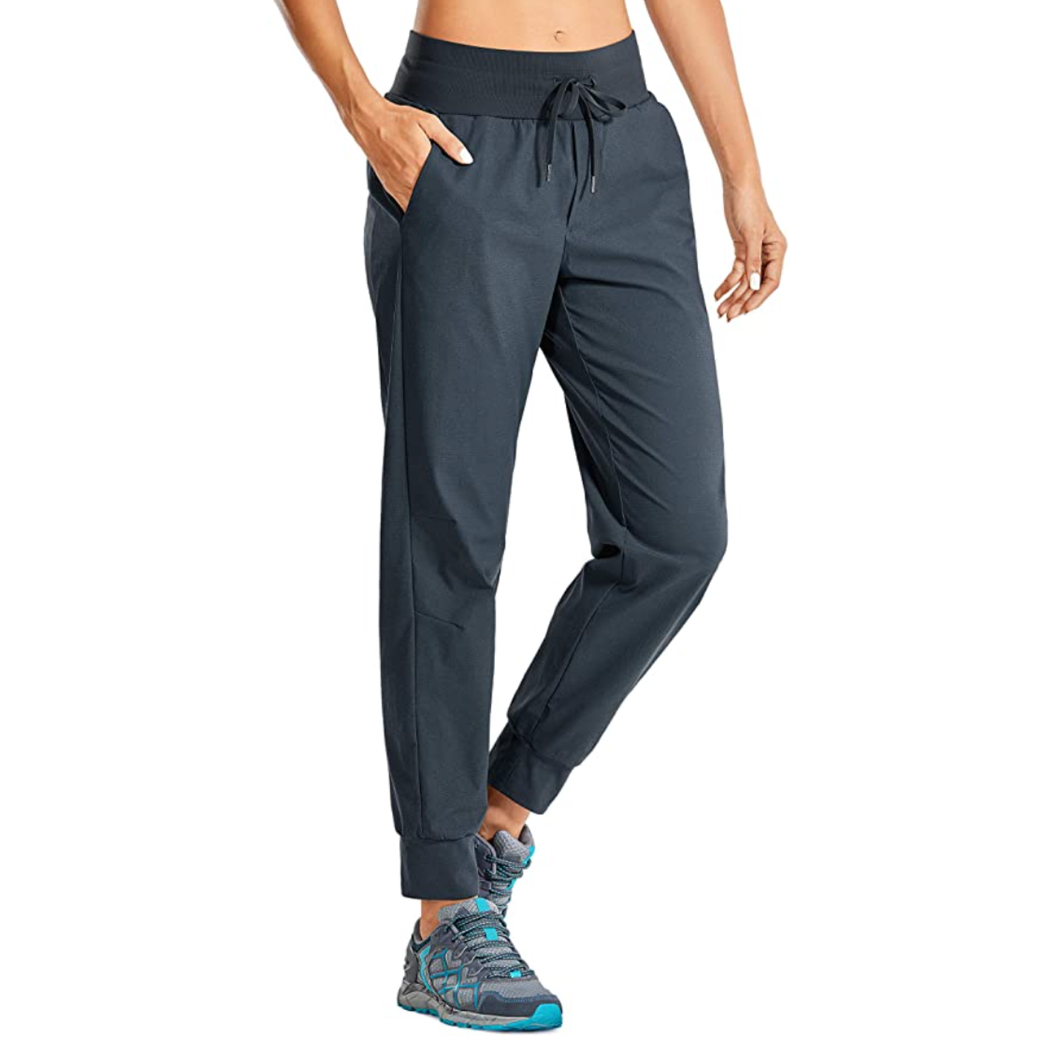 woman wearing ink blue hiking pants and blue tennis shoes