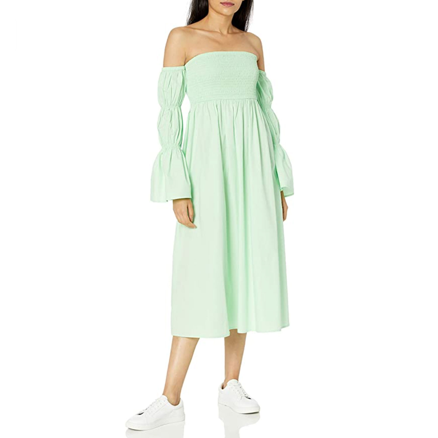 woman wearing mint green off-the-shoulder midi dress with puffed sleeves and wearing white tennis shoes