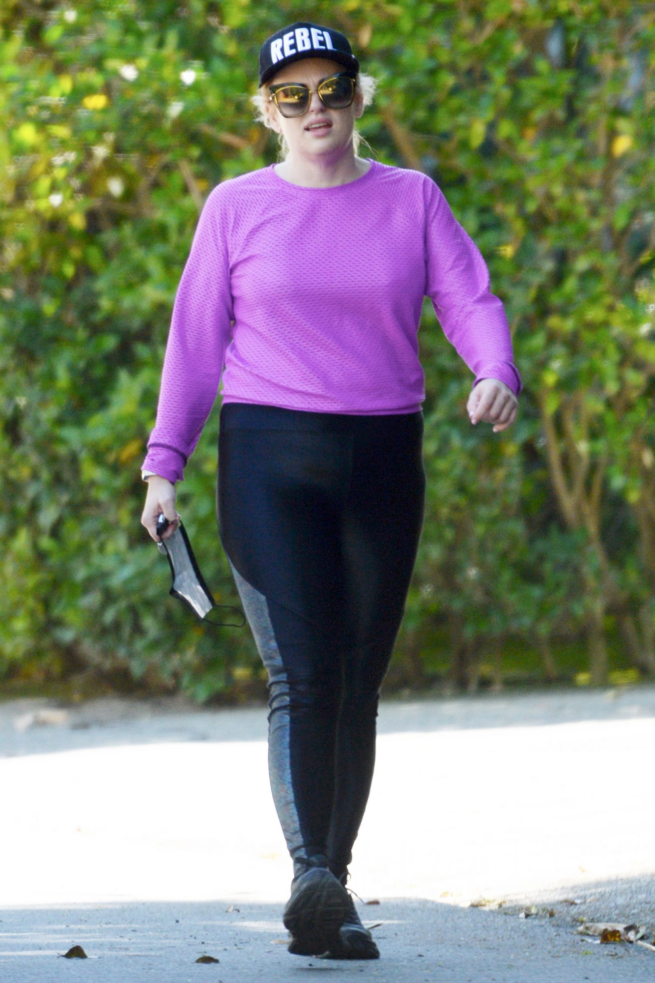 Rebel Wilson Stretches Out Before a Hike as She Celebrates Her 41st Birthday in Los Angeles.