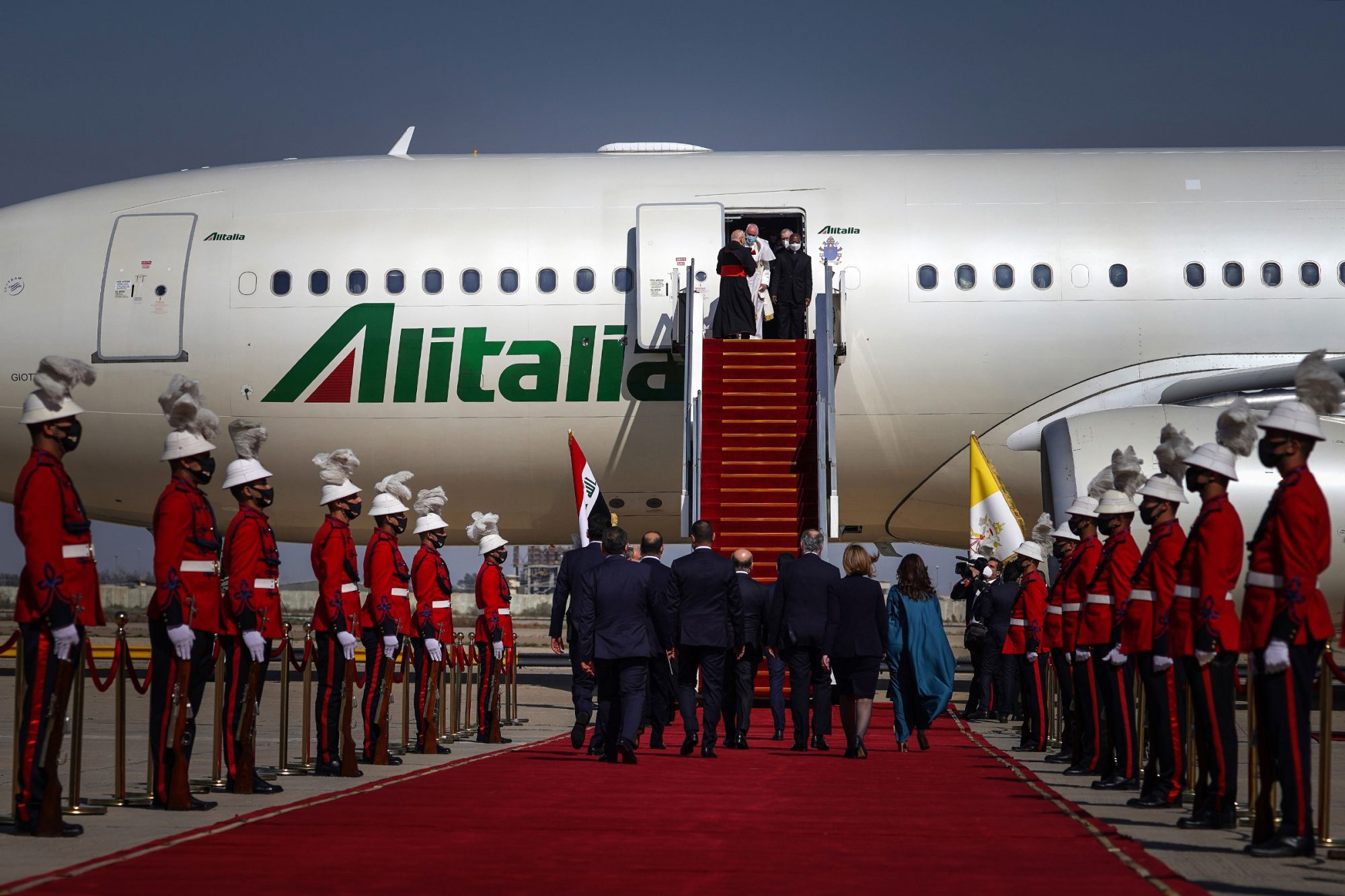 Pope Francis leaves the Alitalia aircraft that transported him to Iraq, at Baghdad Airport, on March 5, 2021