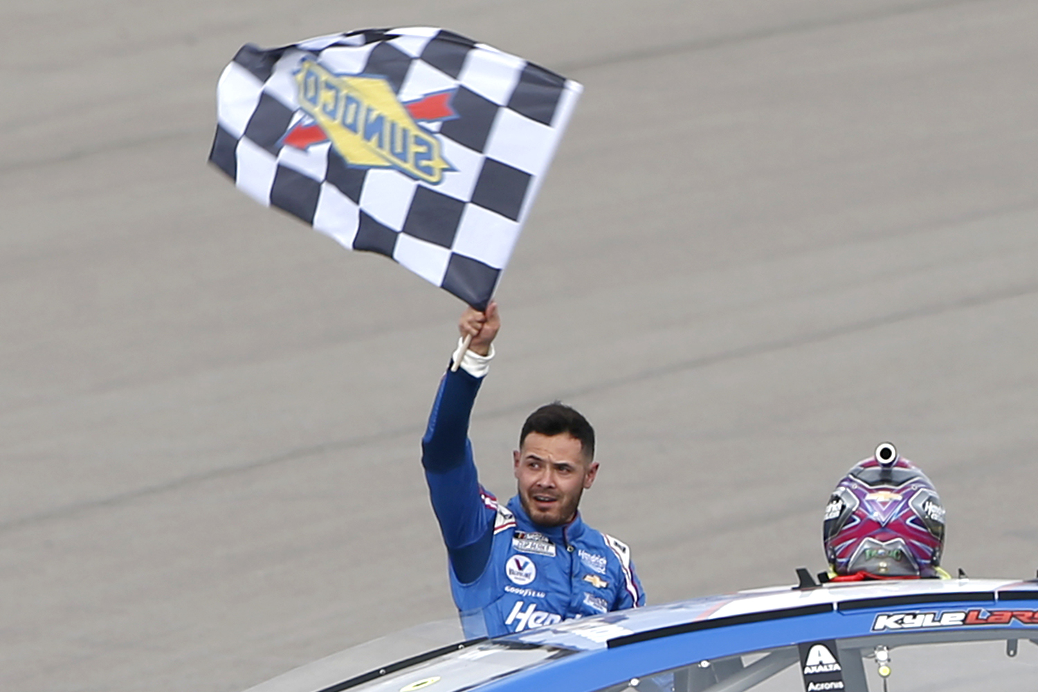 Kyle Larson, driver of the #5 HendrickCars.com Chevrolet, celebrates with the checkered flag after winning the NASCAR Cup