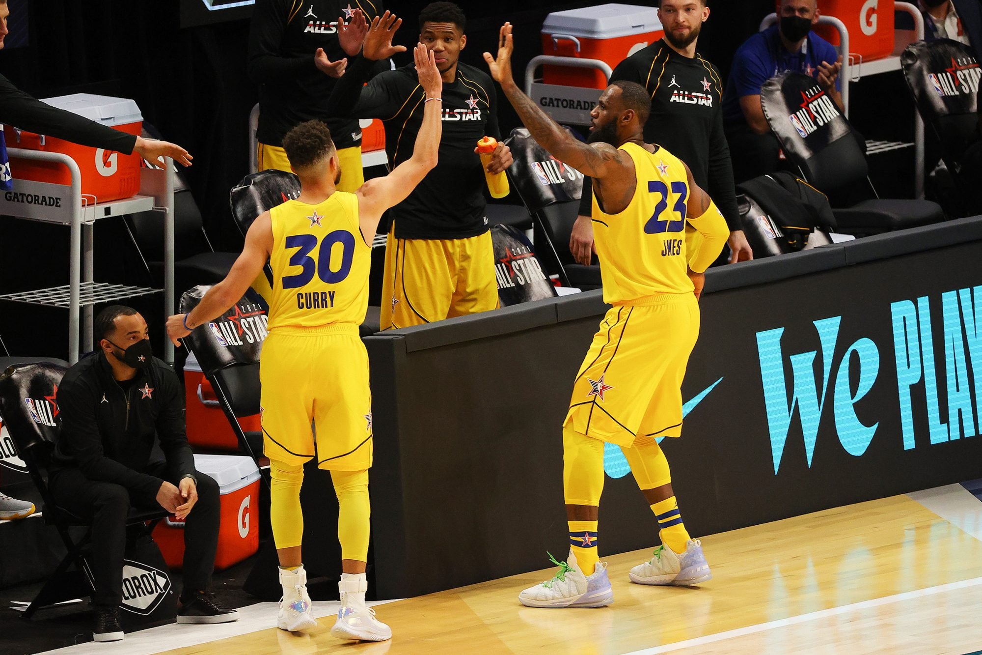 Stephen Curry #30 and LeBron James #23 of Team LeBron high five on the court during the 70th NBA All Star Game