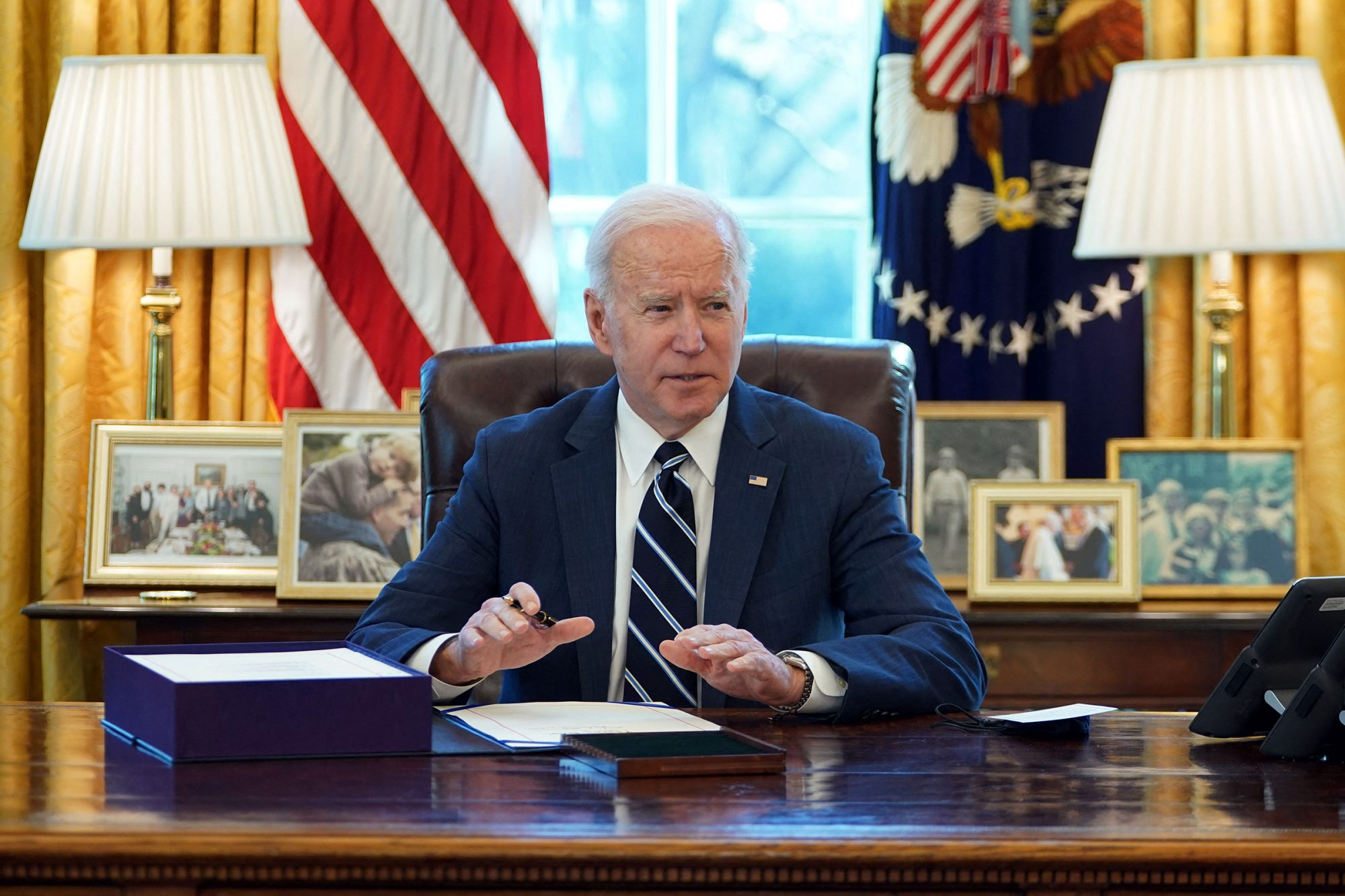 Joe Biden signs the American Rescue Plan on March 11, 2021