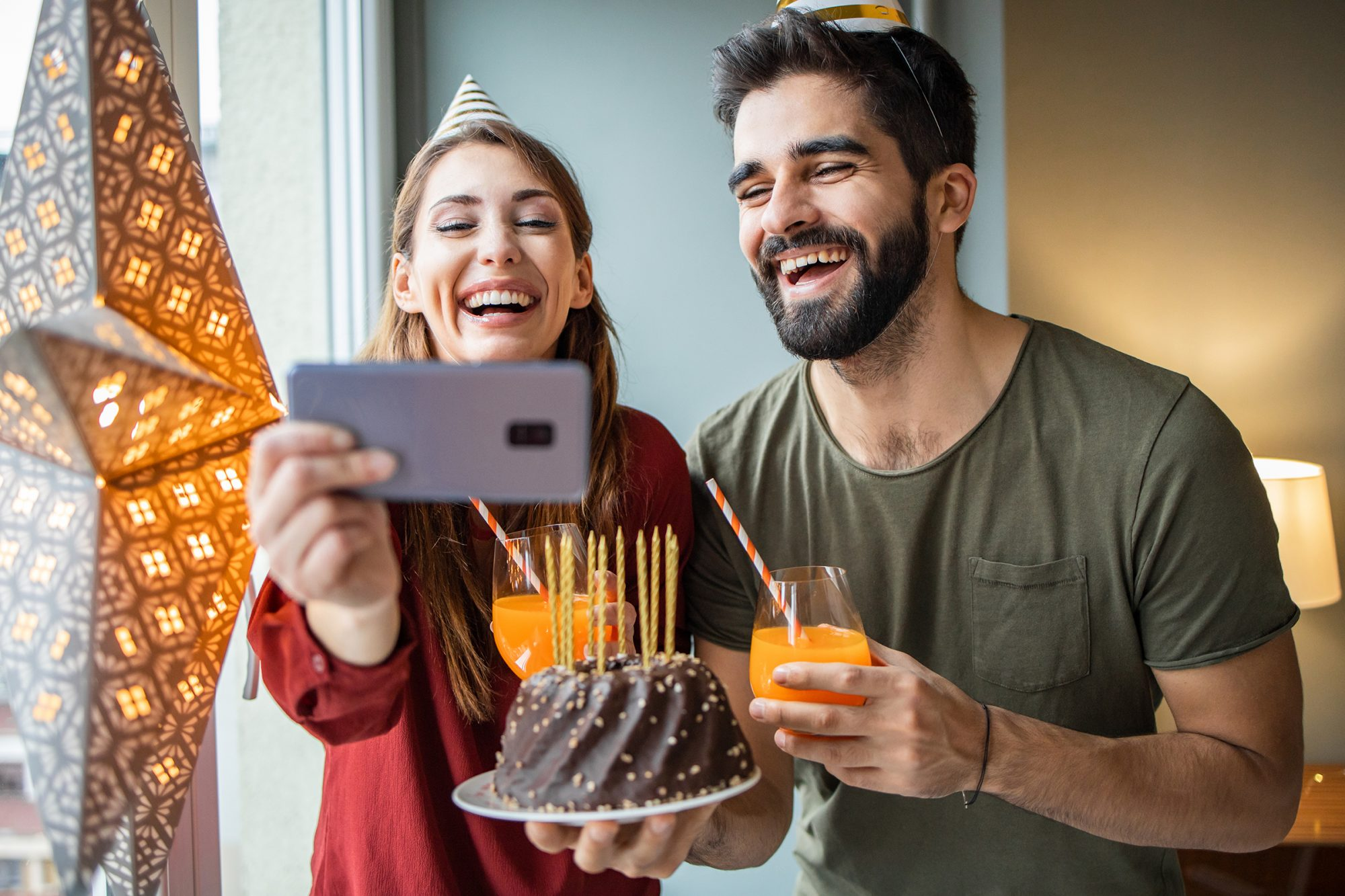 Happy couple on a video call, celebrating birthday