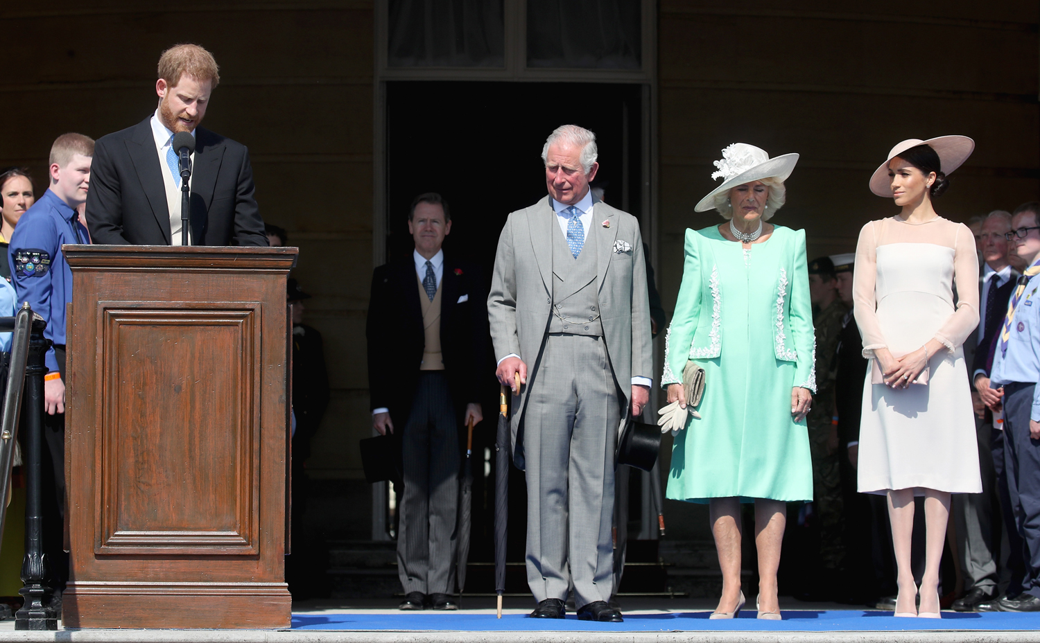 Prince Harry, Duke of Sussex gives a speech next to Prince Charles, Prince of Wales, Camilla, Duchess of Cornwall and Meghan, Duchess of Sussex