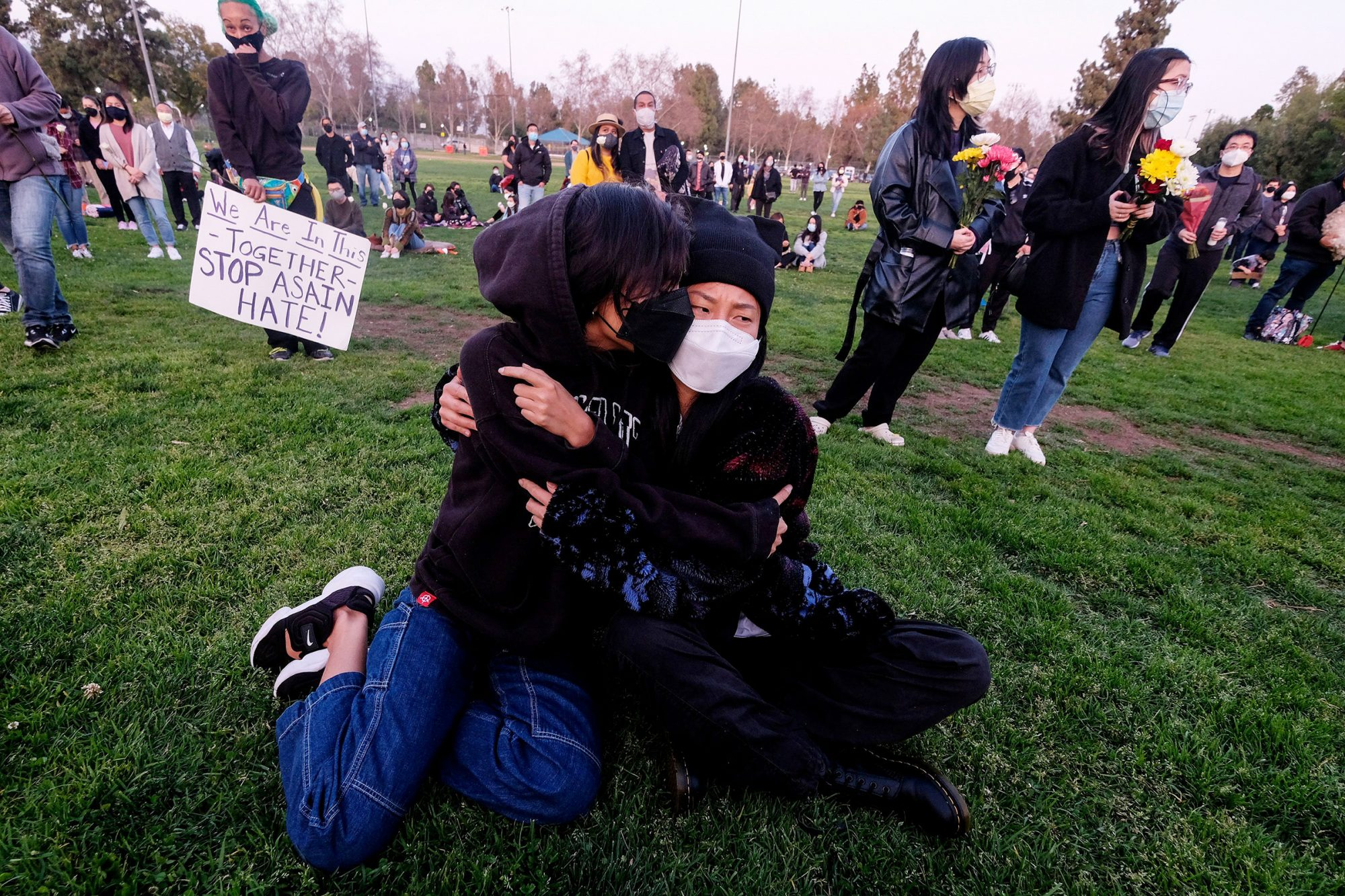 People take part in a candlelight vigil in standing up against Asian American Pacific Islander (AAPI) hate and violence, at Almansor Park in Alhambra, California, on March 20, 2021