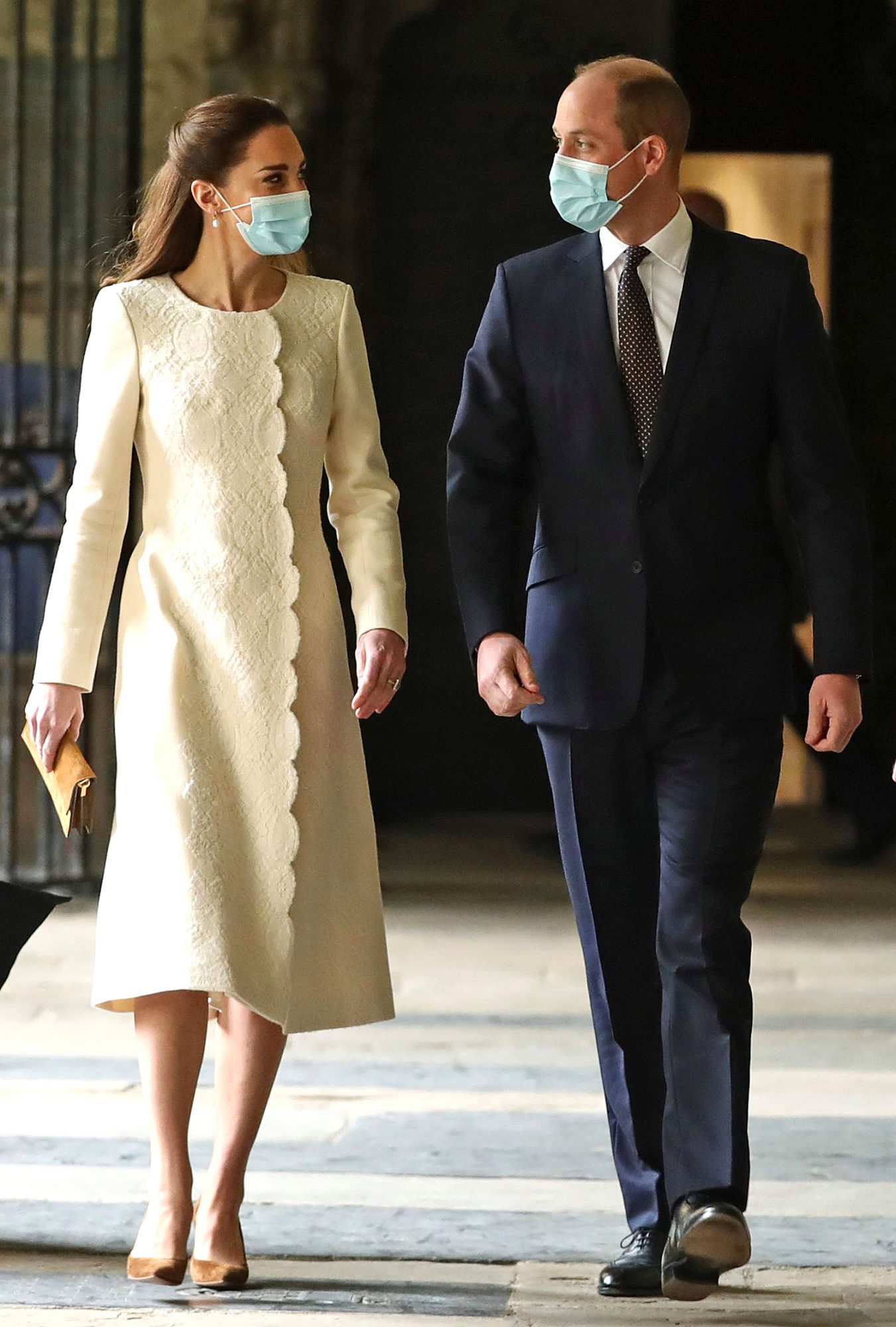 Prince William and Kate, Duchess of Cambridge arrive for a visit to the vaccination center at Westminster Abbey