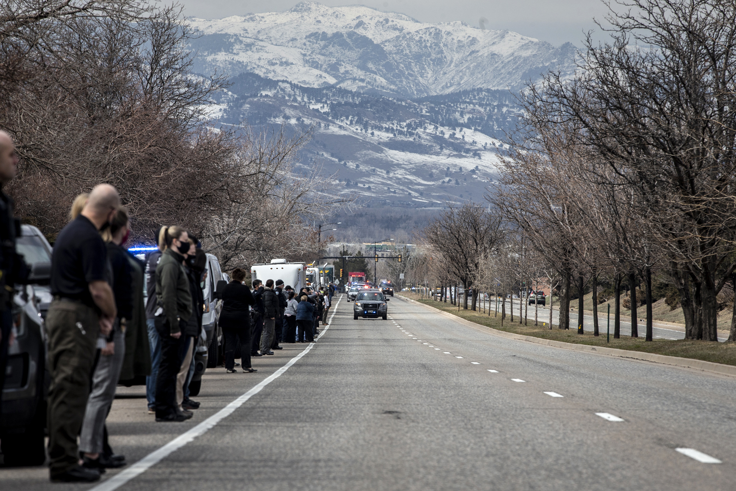 Law enforcement vehicles escort the body of slain Boulder Police Officer Eric Talley