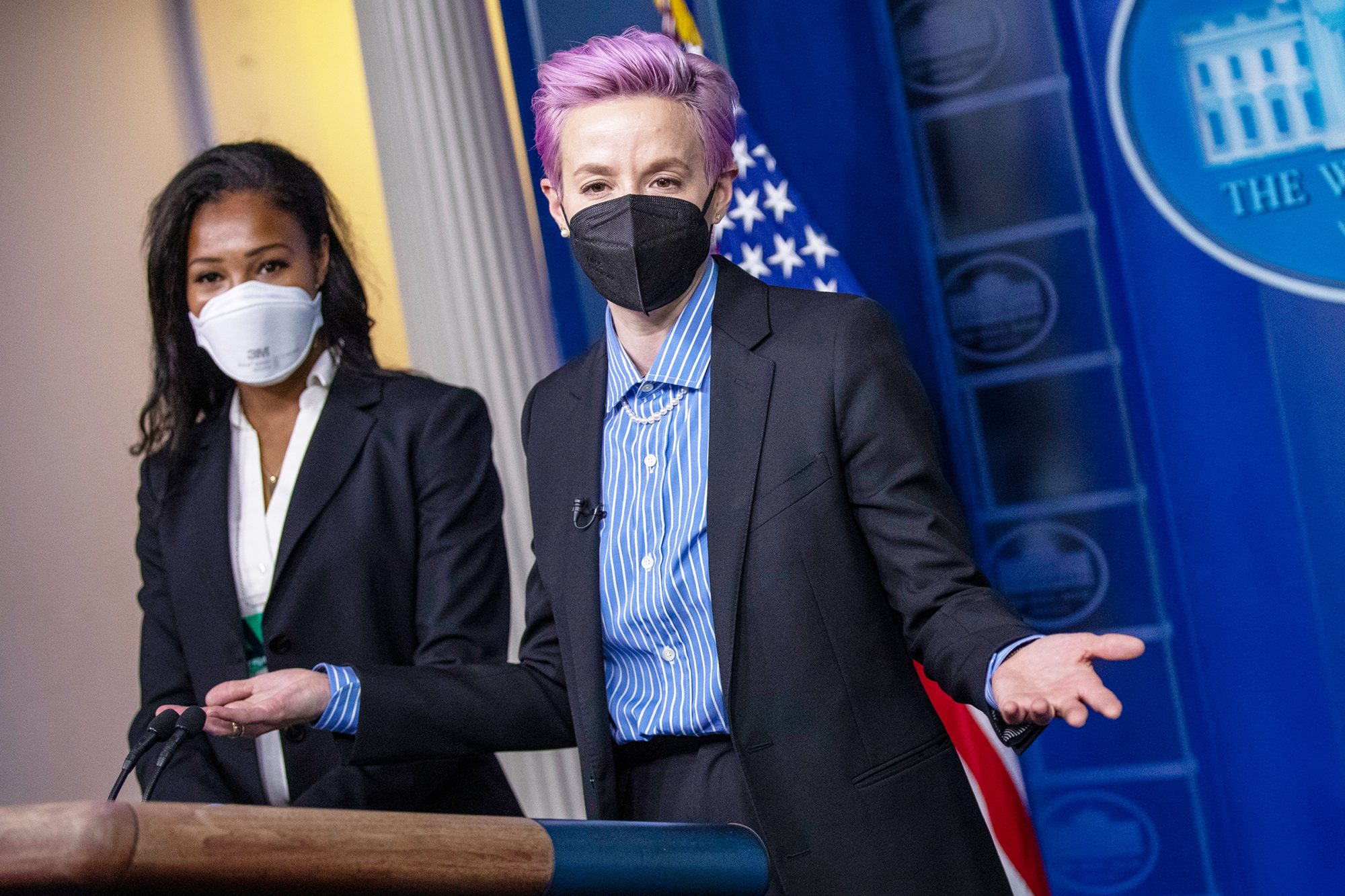 American professional soccer players Megan Rapinoe (R) and Margaret Purce (L) have their picture taken at the briefing room podium prior to the event to mark Equal Pay Day in the State Dining Room of the White House in Washington, DC, USA, 24 March 2021