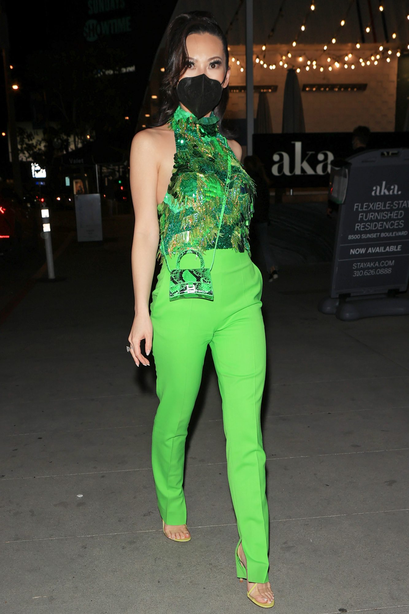 Christine Chiu stuns in a green outfit as she heads to dinner at Tesse