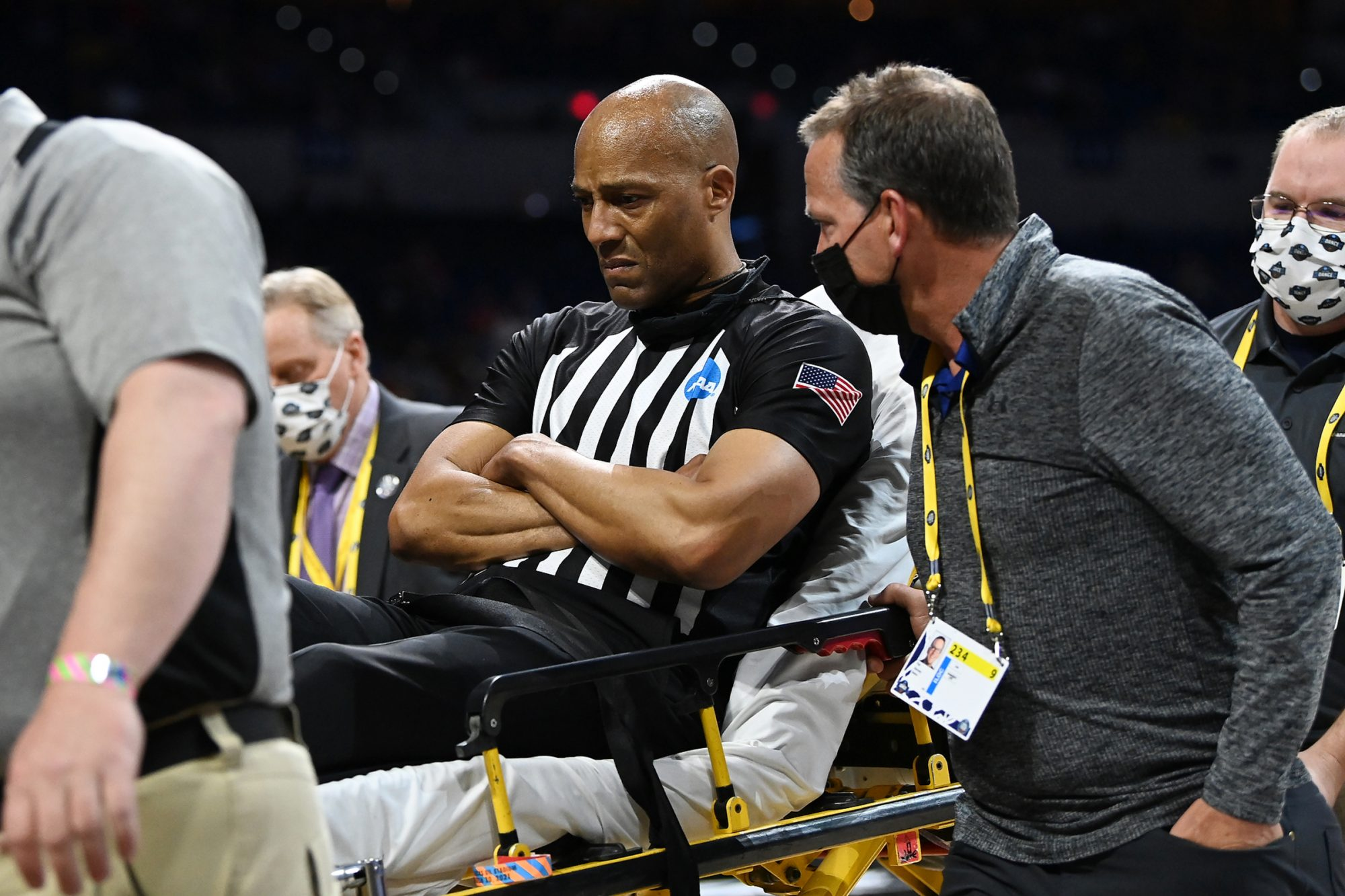 Referee Bert Smith is wheeled away after collapsing in the Elite Eight round game of the 2021 NCAA Division I Men's Basketball Tournament game between the Gonzaga Bulldogs and the USC Trojans at Lucas Oil Stadium on March 30, 2021 in Indianapolis, Indiana