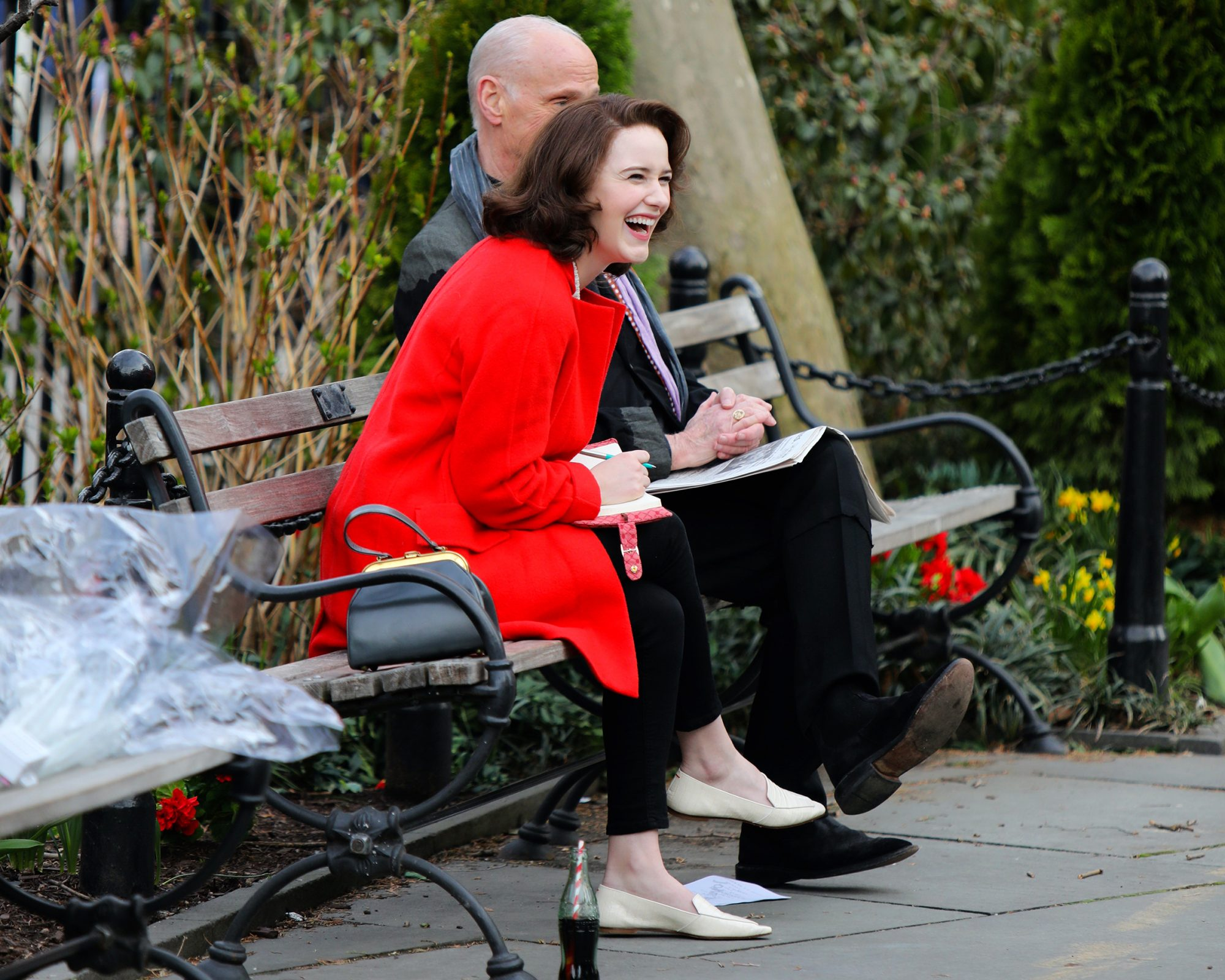 """Rachel Brosnahan and John Waters are all laughs while filming at """"The Marvelous Mrs Maisel"""" set in Downtown, Manhattan."""