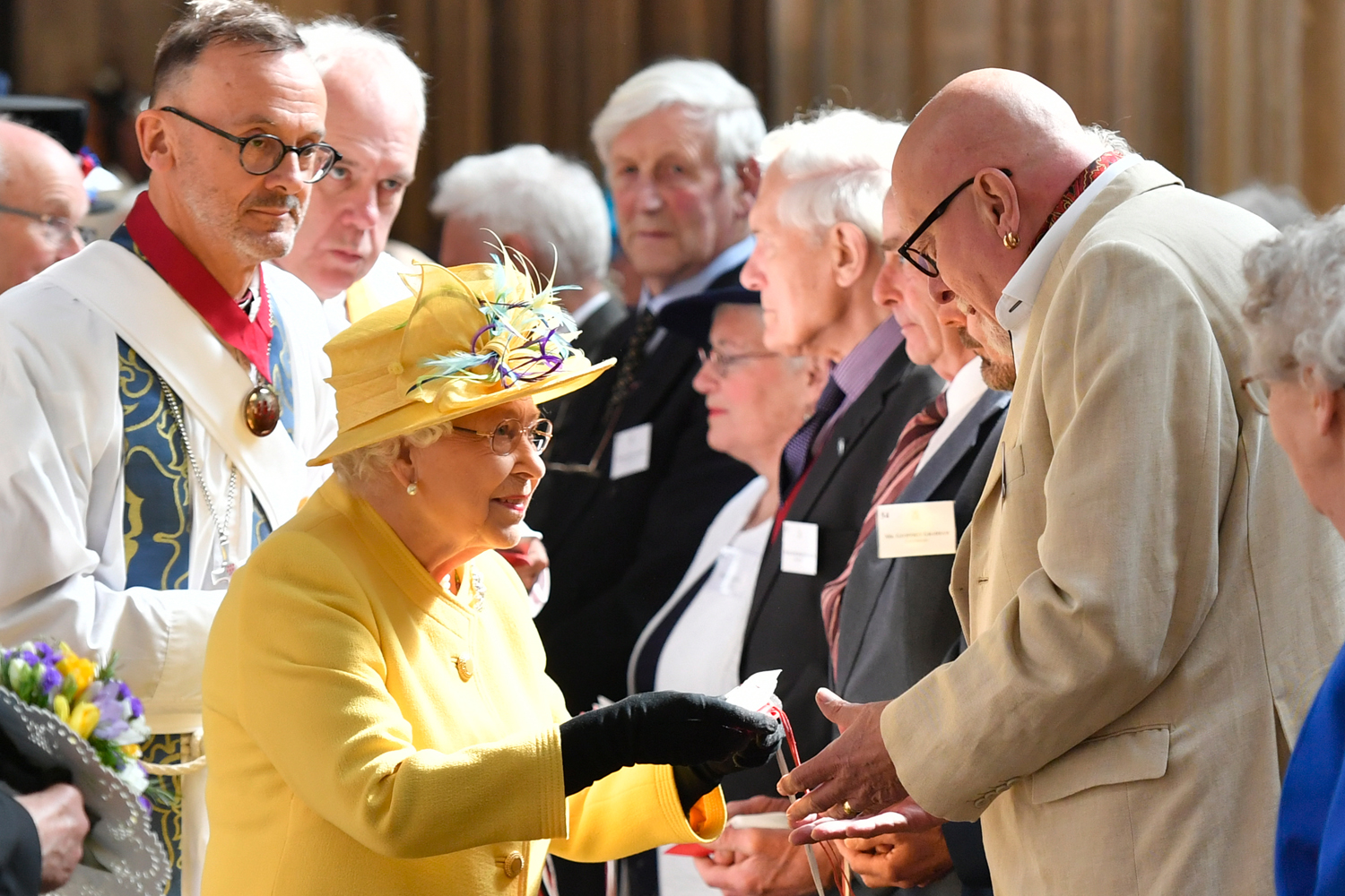 Britain's Queen Elizabeth II distributes the Maundy money during the Royal Maundy Service at St George's Chapel