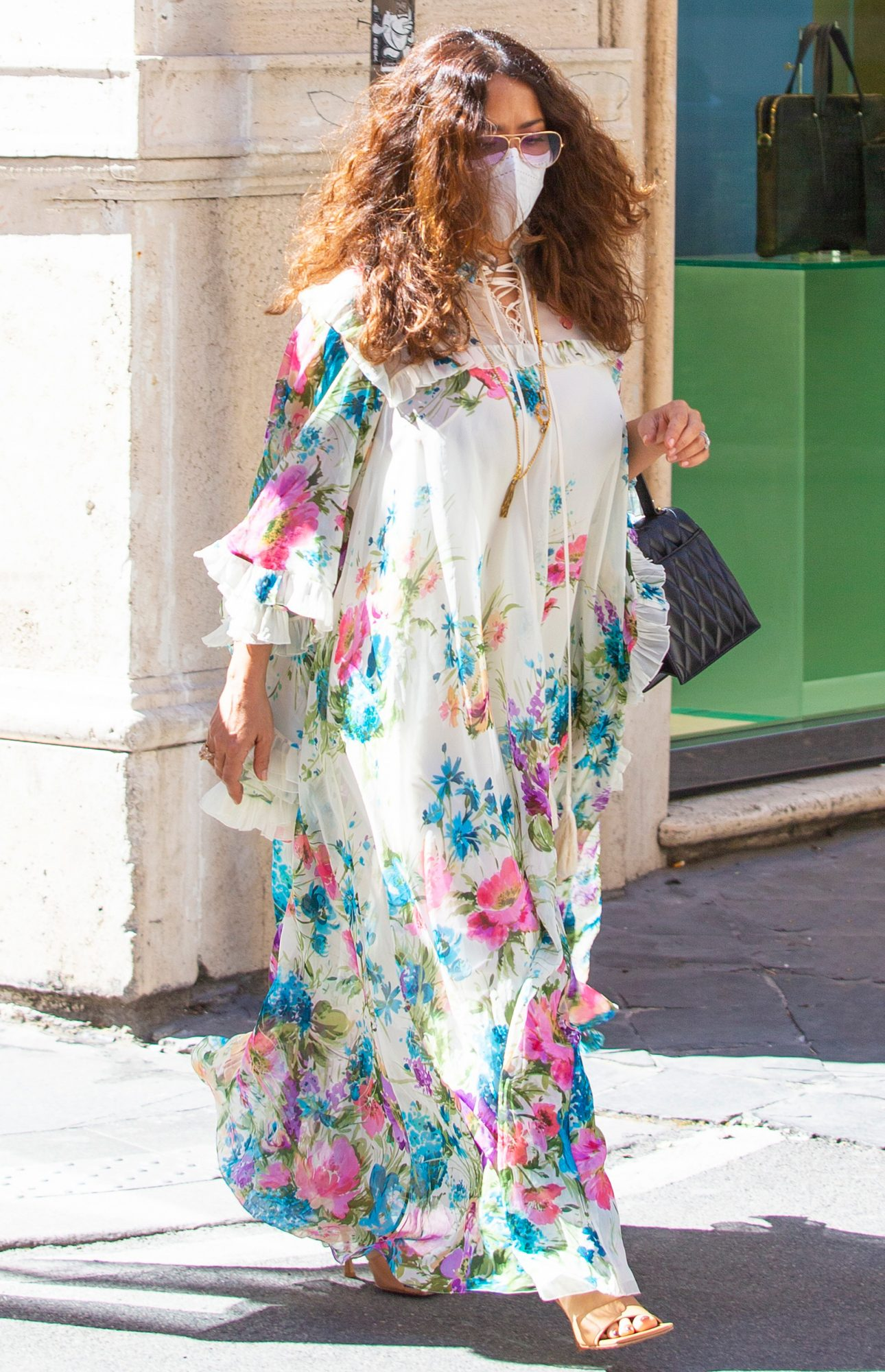 Salma Hayek seen strolling in Rome, wearing a flowered gown