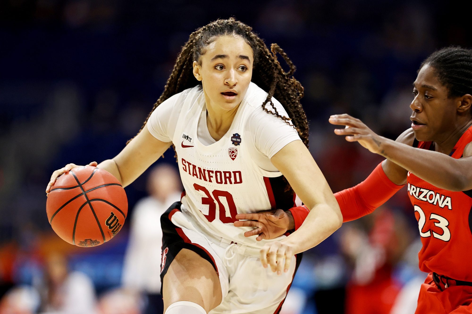 Haley Jones #30 of the Stanford Cardinal brings the ball up the court against Bendu Yeaney #23 of the Arizona Wildcats in the National Championship game of the 2021 NCAA Women's Basketball Tournament at the Alamodome on April 04, 2021 in San Antonio, Texas