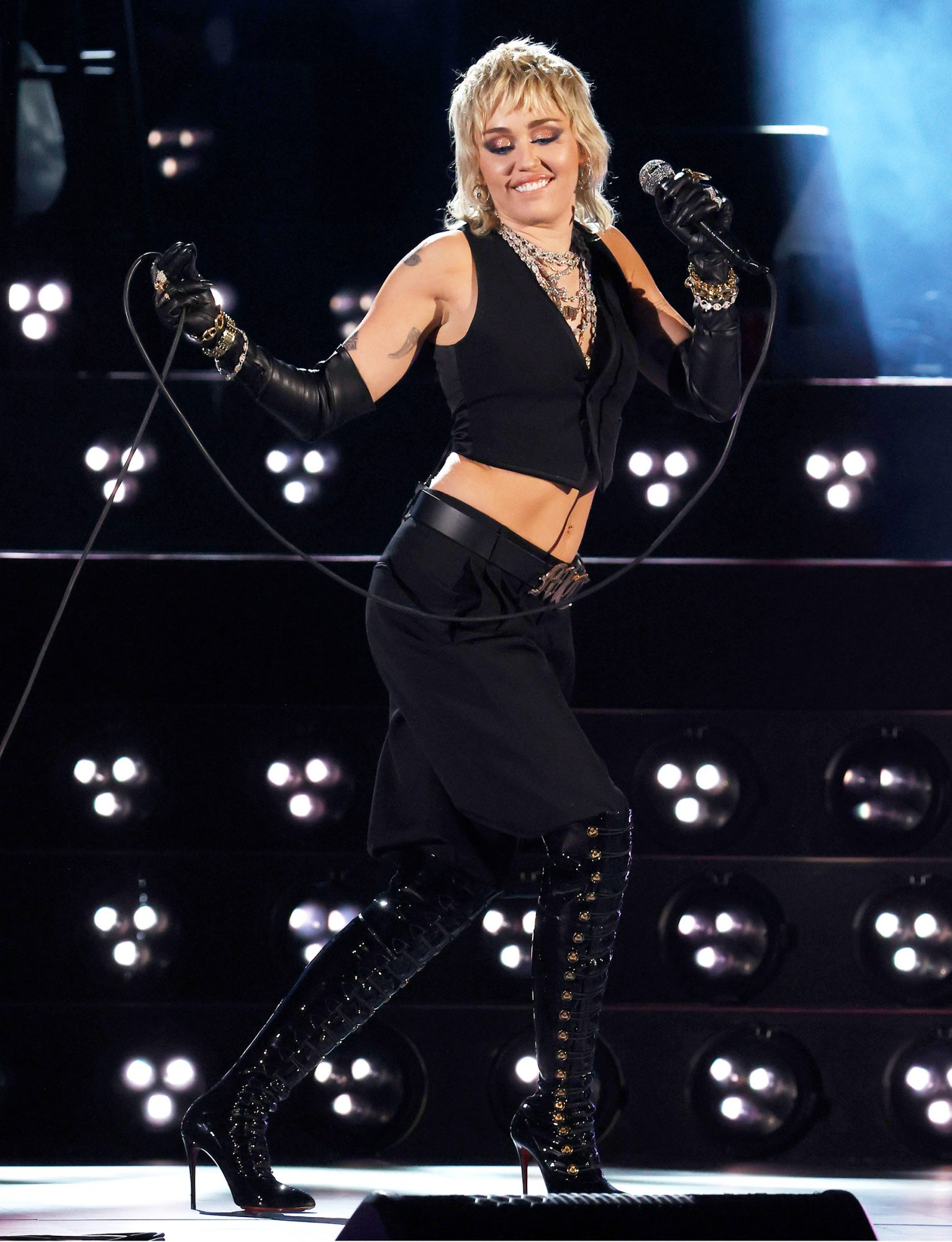Miley Cyrus performs a Tribute to Frontline Heroes during the 2021 NCAA Final Four at Lucas Oil Stadium on April 03, 2021 in Indianapolis, Indiana