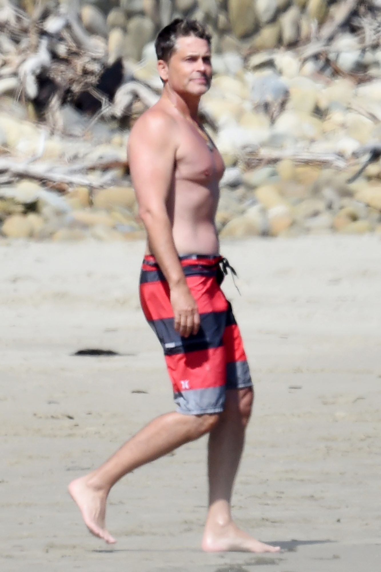 Rob Lowe goes shirtless jumping into the ocean with his son Matthew at the beach on Easter weekend in Santa Barbara Saturday
