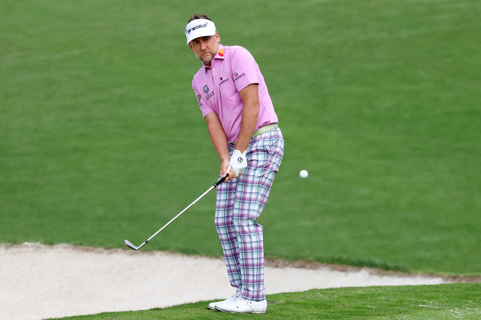 Ian Poulter of England plays a shot on the 10th hole during the final round of the Masters at Augusta National Golf Club on November 15, 2020 in Augusta, Georgia