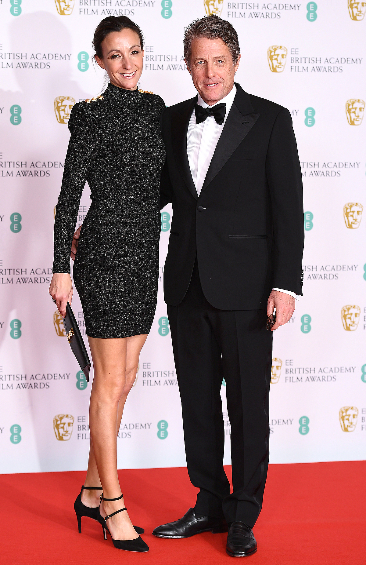 Hugh Grant and wife Anna Elisabet Eberstein attends the EE British Academy Film Awards 2021 at the Royal Albert Hall on April 11, 2021