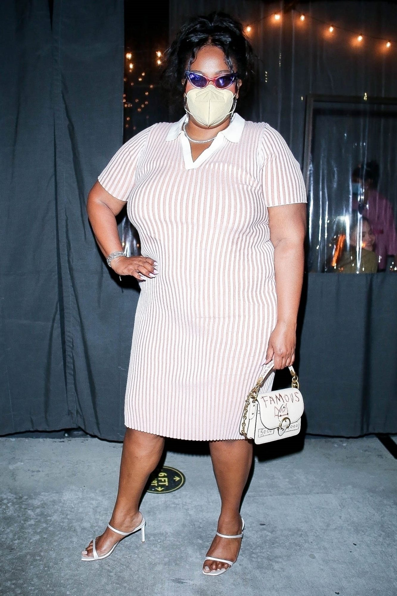 Lizzo looks stunning as she flaunts her curves in a pink and white striped dress while leaving dinner at Crossroads Kitchen in Los Angeles