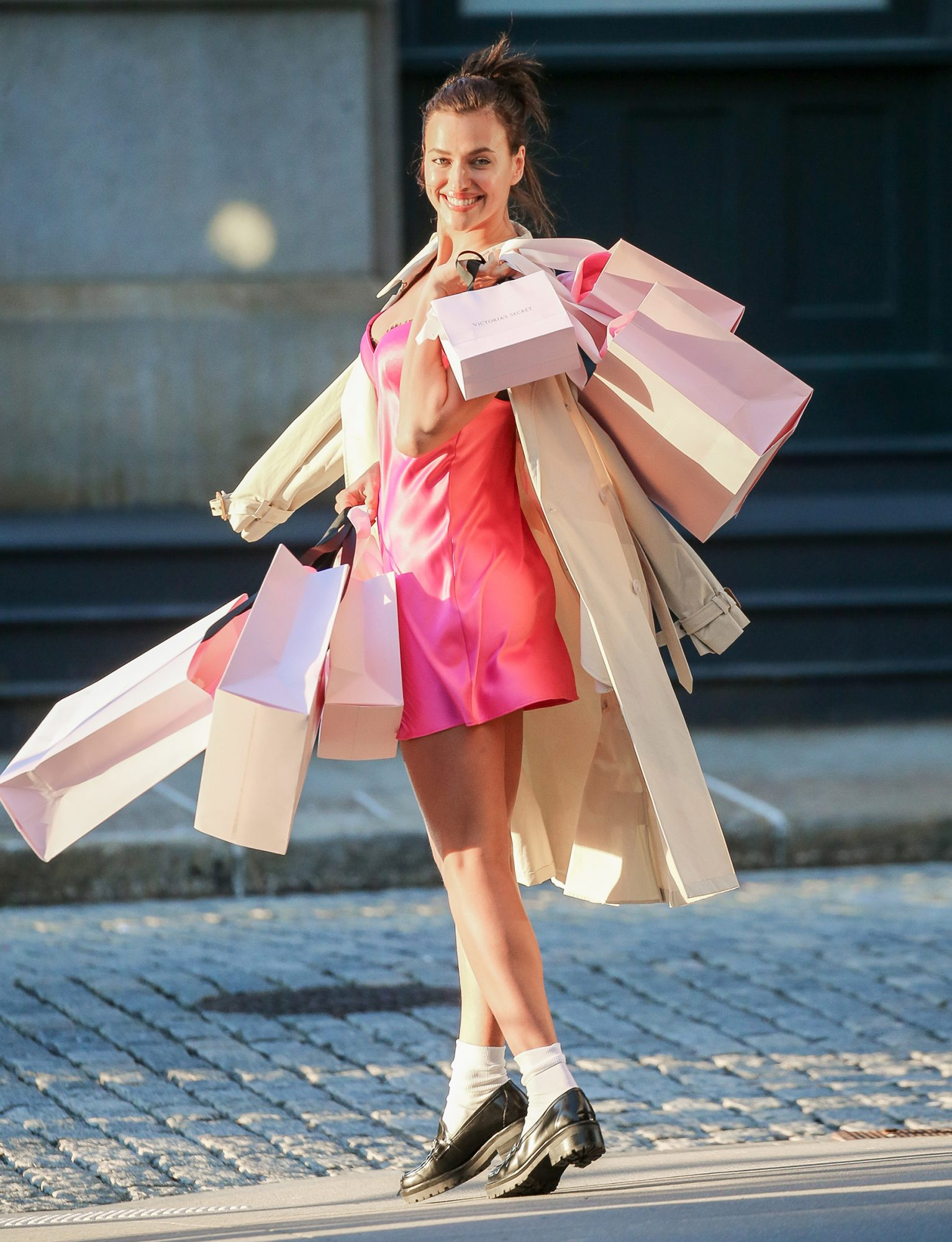 Irina Shayk flash a big smile while she's all full hands with Shopping bags while doing a photoshoot for Victoria Secret in Tribeca, NYC
