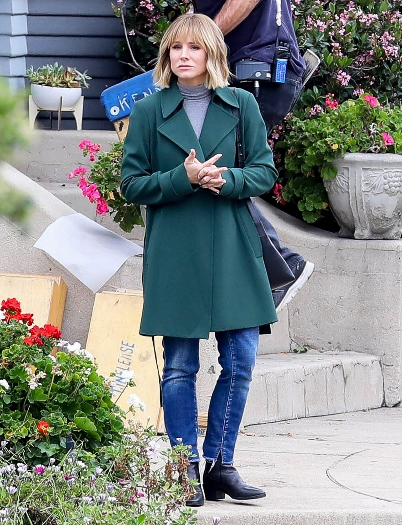 Kristen Bell is spotted on location in Los Angeles filming a scene for Netflix's mini-series 'The Woman in the House'.