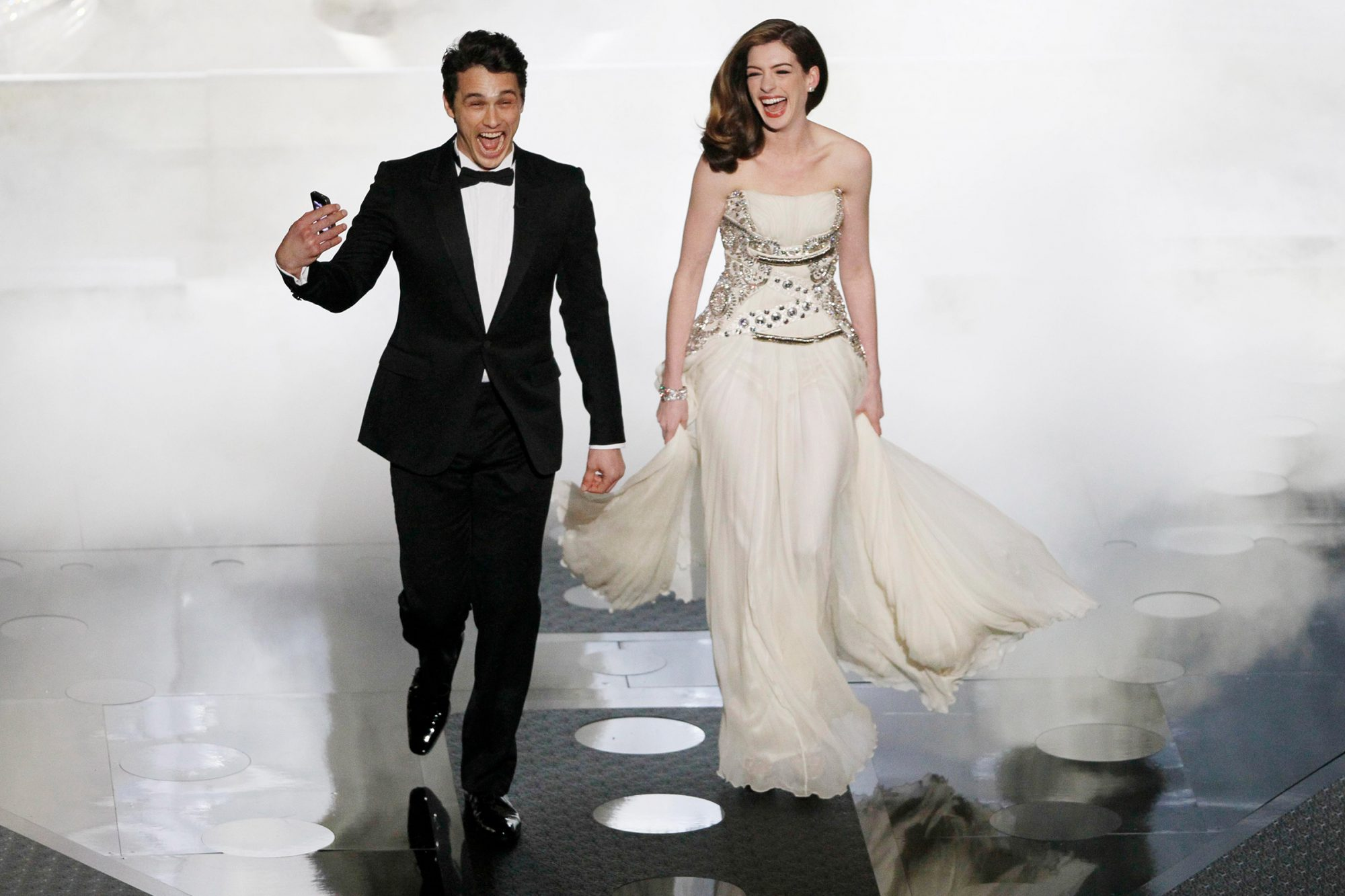 James Franco and Anne Hathaway enter the stage during the 83rd Annual Academy Awards