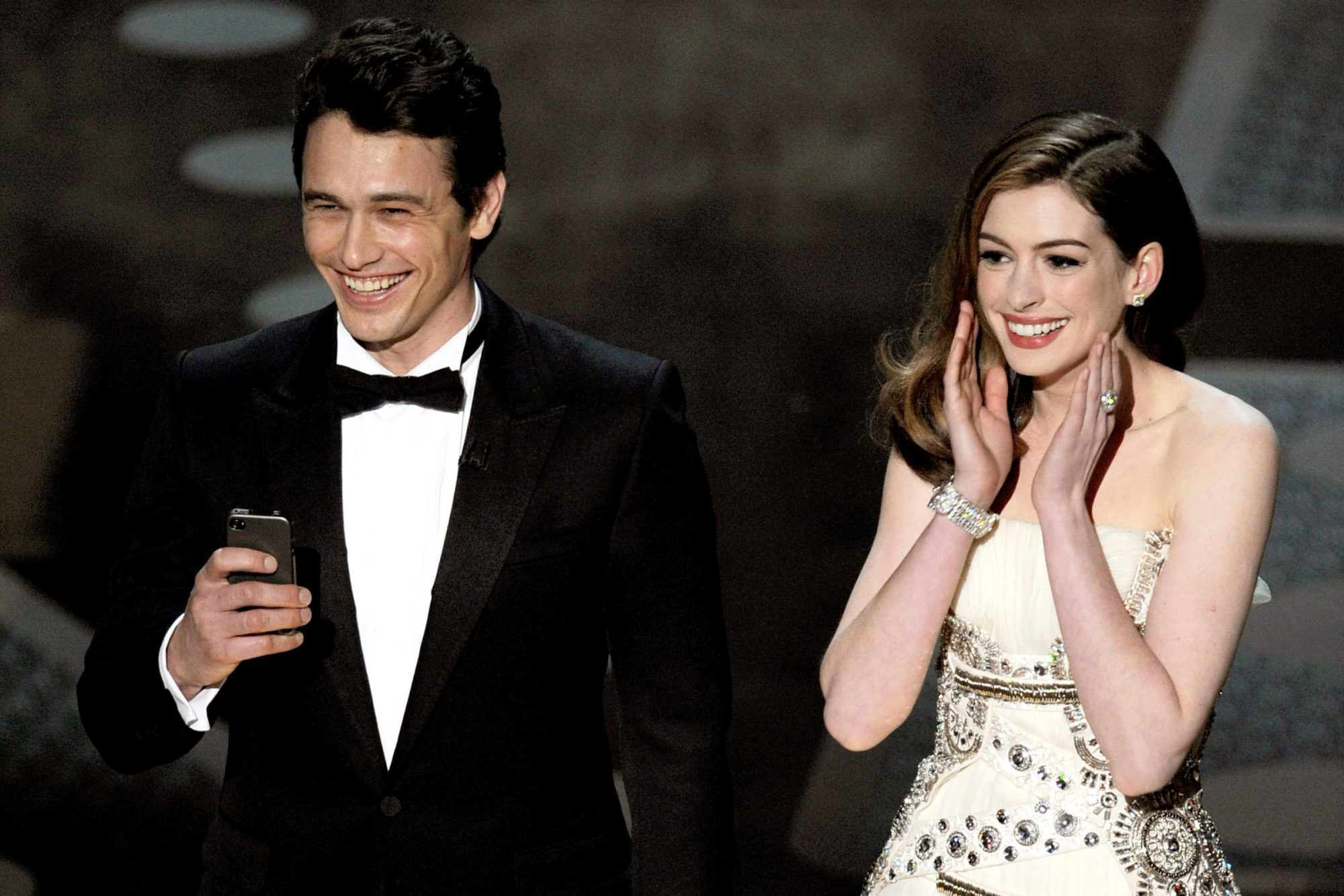James Franco and Anne Hathaway speak onstage during the 83rd Annual Academy Awards