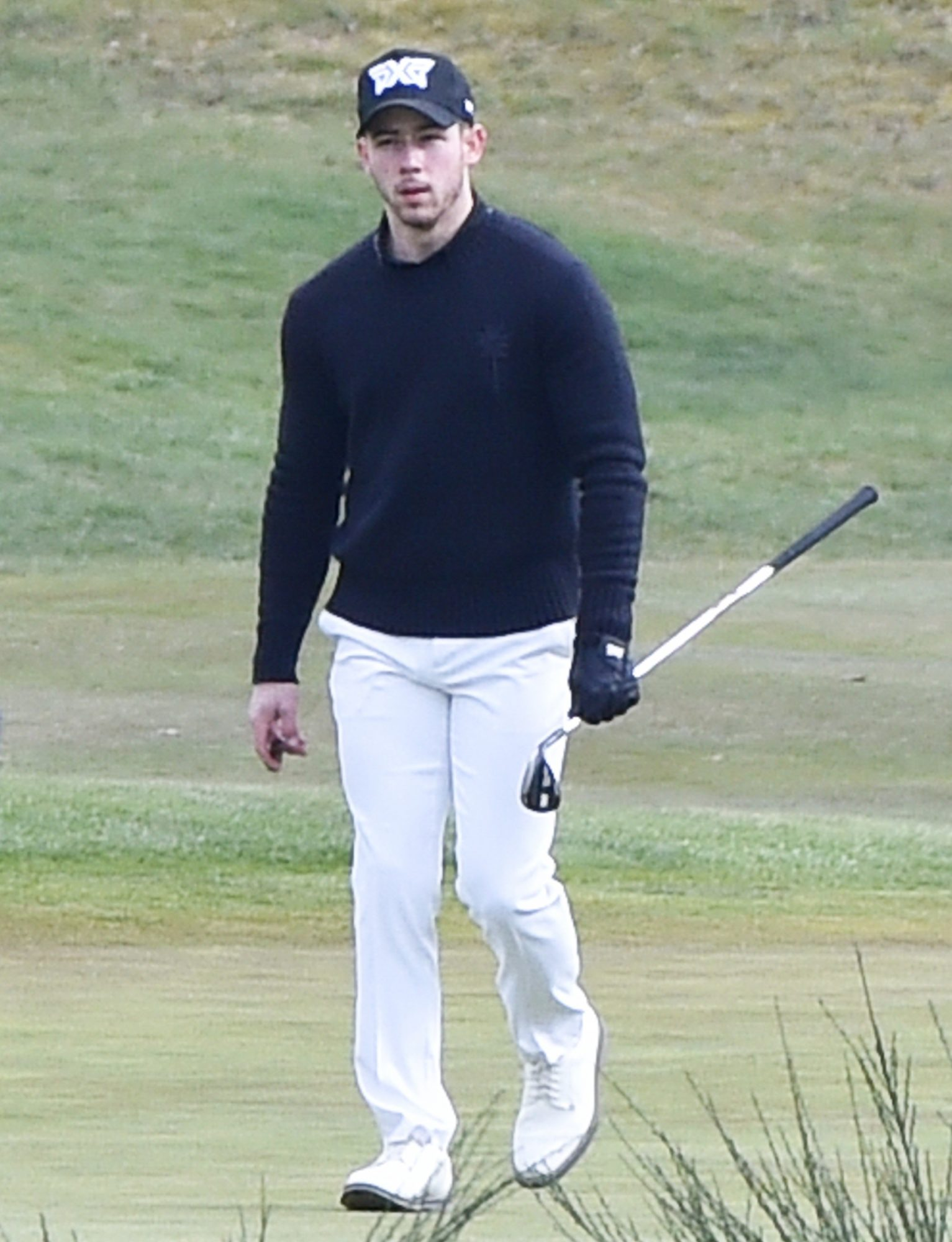 Nick Jonas Puffs On A Cigar As He's Seen Playing Golf With A Pal At Sunningdale Golf Course In Surrey