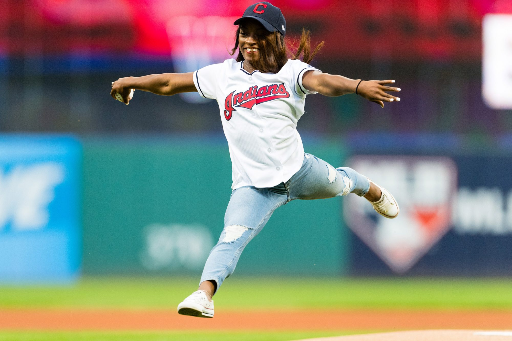 Simone Biles throws out the first pitch prior to the game between the Cleveland Indians and the Baltimore Orioles at Progressive Field on September 8, 2017