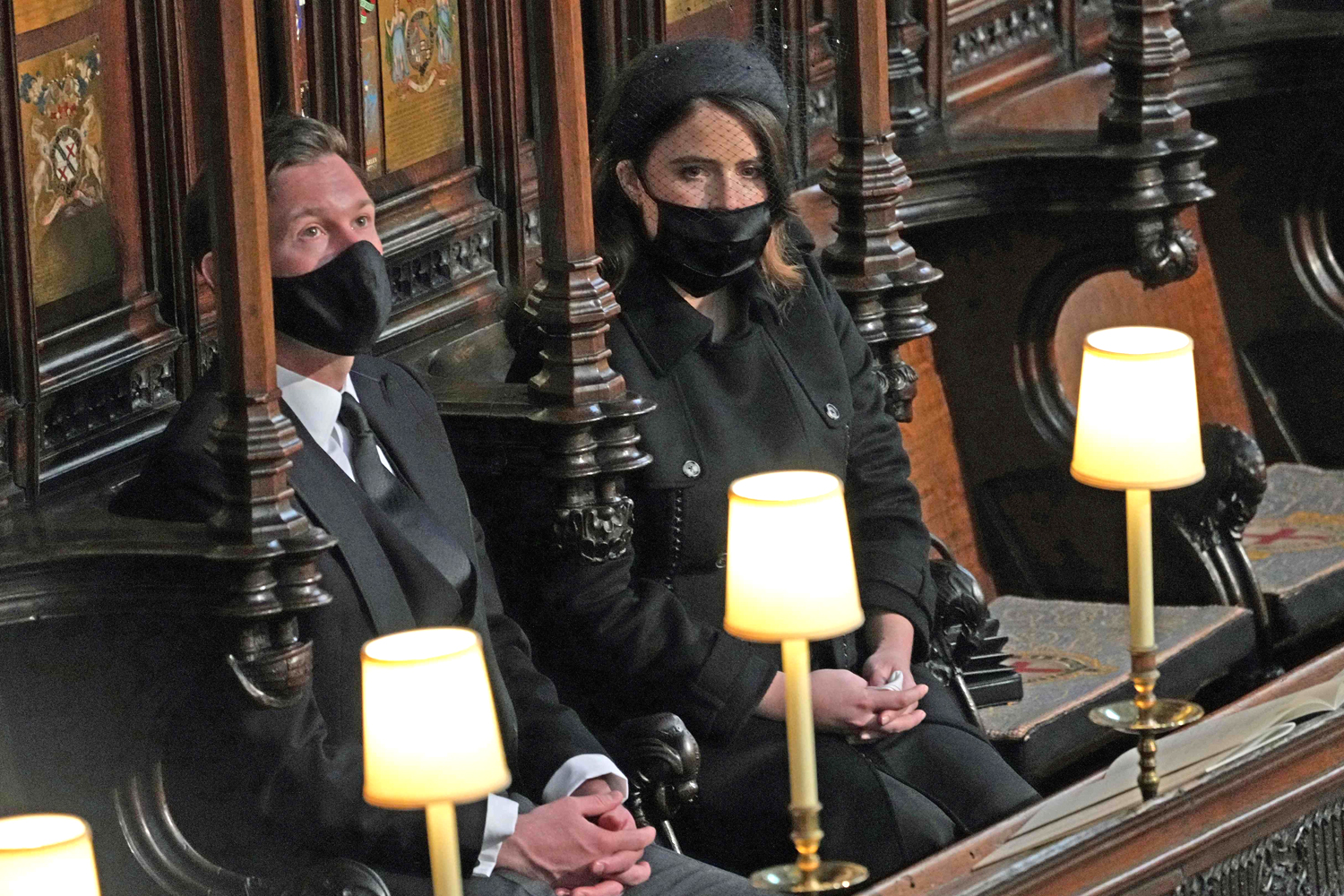Britain's Princess Eugenie of York (R) and her husband Jack Brooksbank attend the funeral of Britain's Prince Philip, Duke of Edinburgh