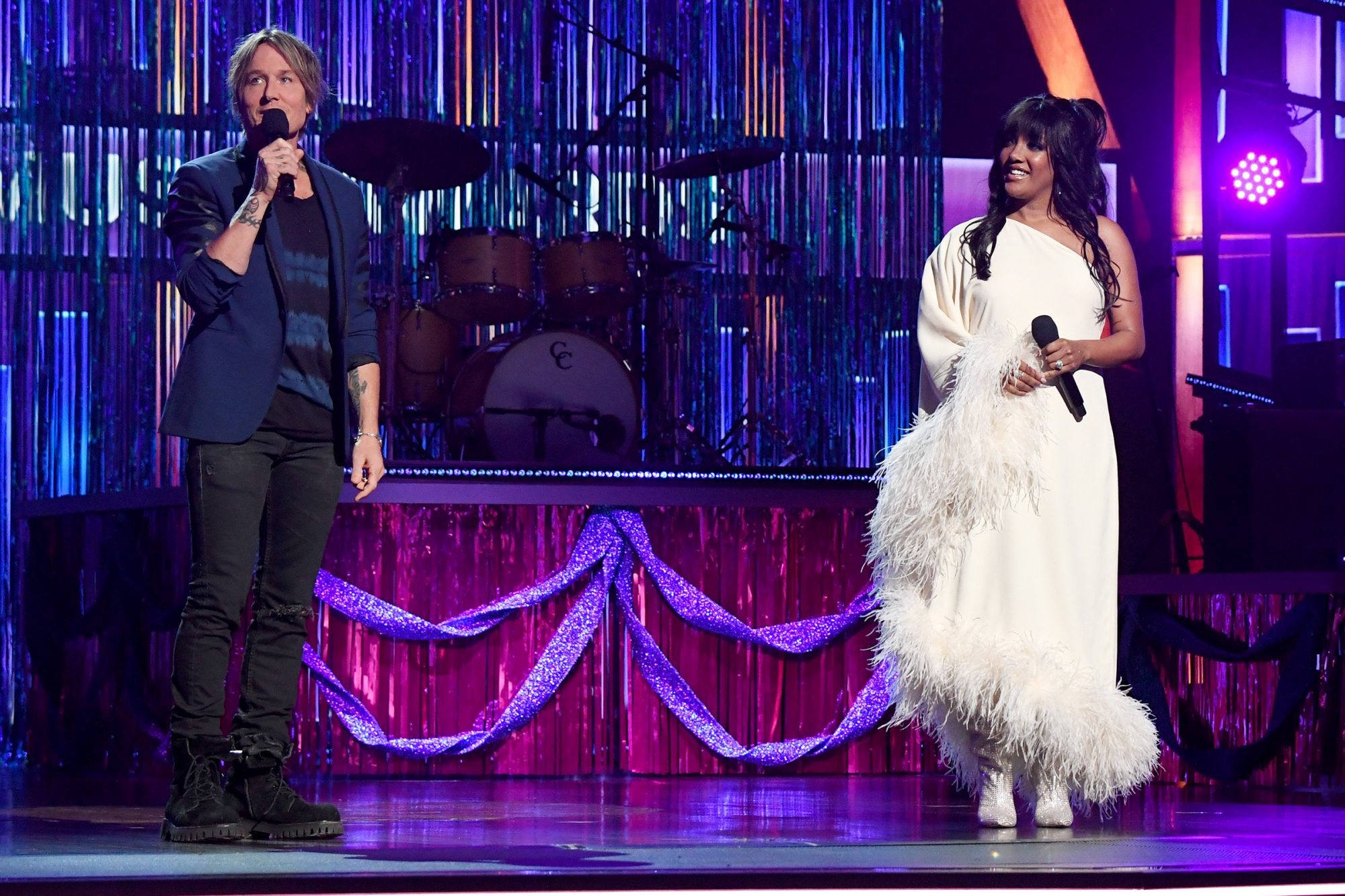 co-hosts Keith Urban and Mickey Guyton speak onstage at the 56th Academy of Country Music Awards