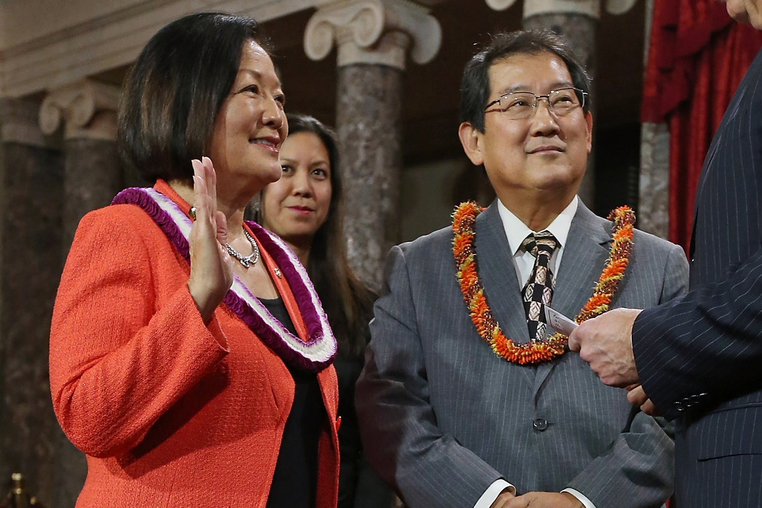 Mazie Hirono participates in a reenacted swearing-in with her husband Leighton Kim Oshima