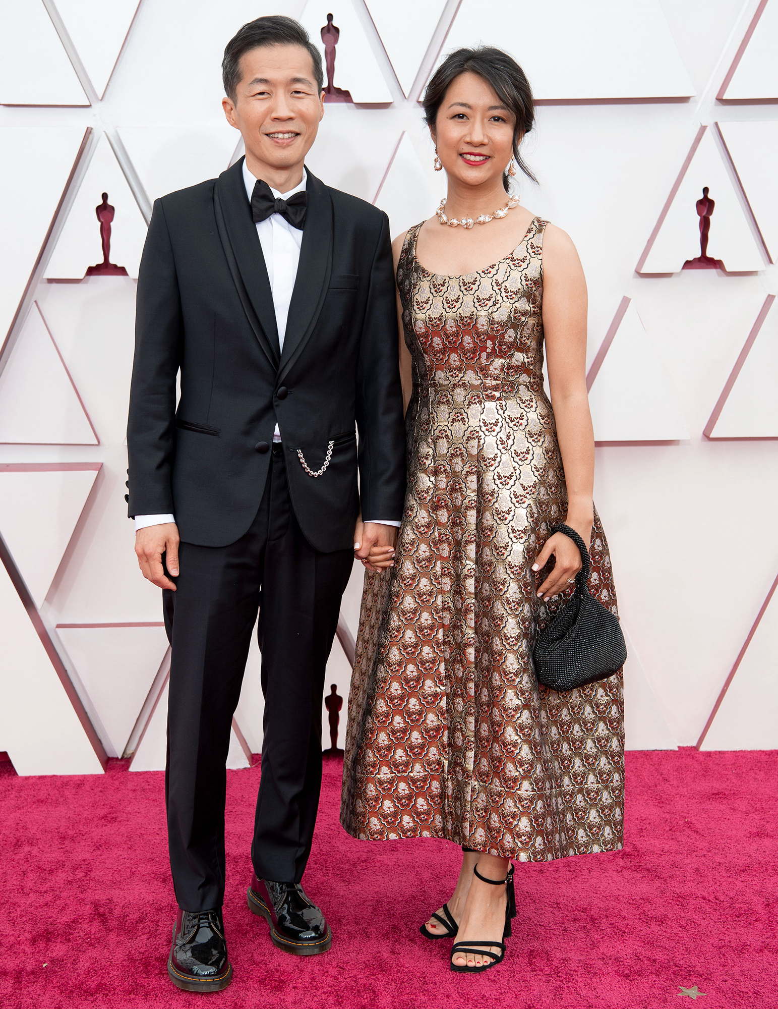 Lee Isaac Chung, who was nominated for Best Director and Best Original Screenplay for Minari, smiled and held hands with his wife, Valerie Chung, on the red carpet.