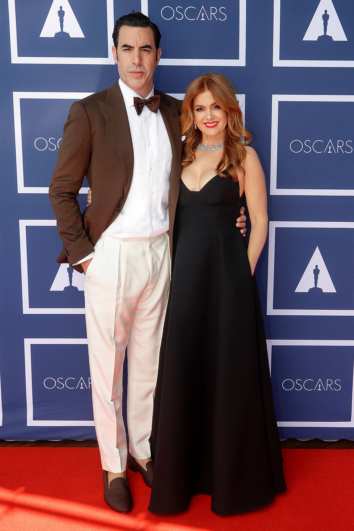 Sacha Baron Cohen and Isla Fisher arrive to attend a screening of the Oscars 93rd Annual Academy Awards