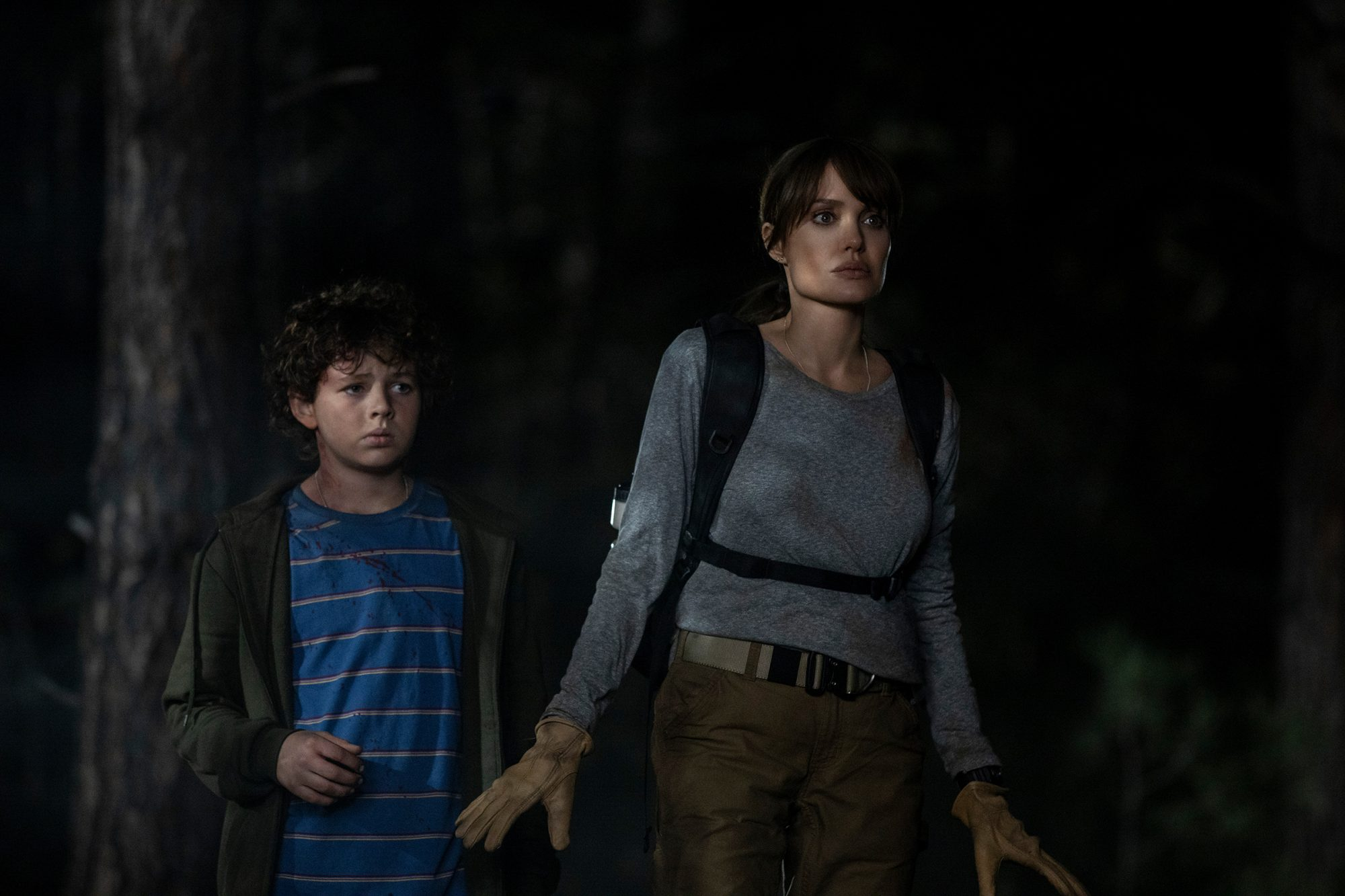 """(L-r) FINN LITTLE as Connor and ANGELINA JOLIE as Hannah in New Line Cinema's thriller """"THOSE WHO WISH ME DEAD,"""" a Warner Bros. Pictures release."""
